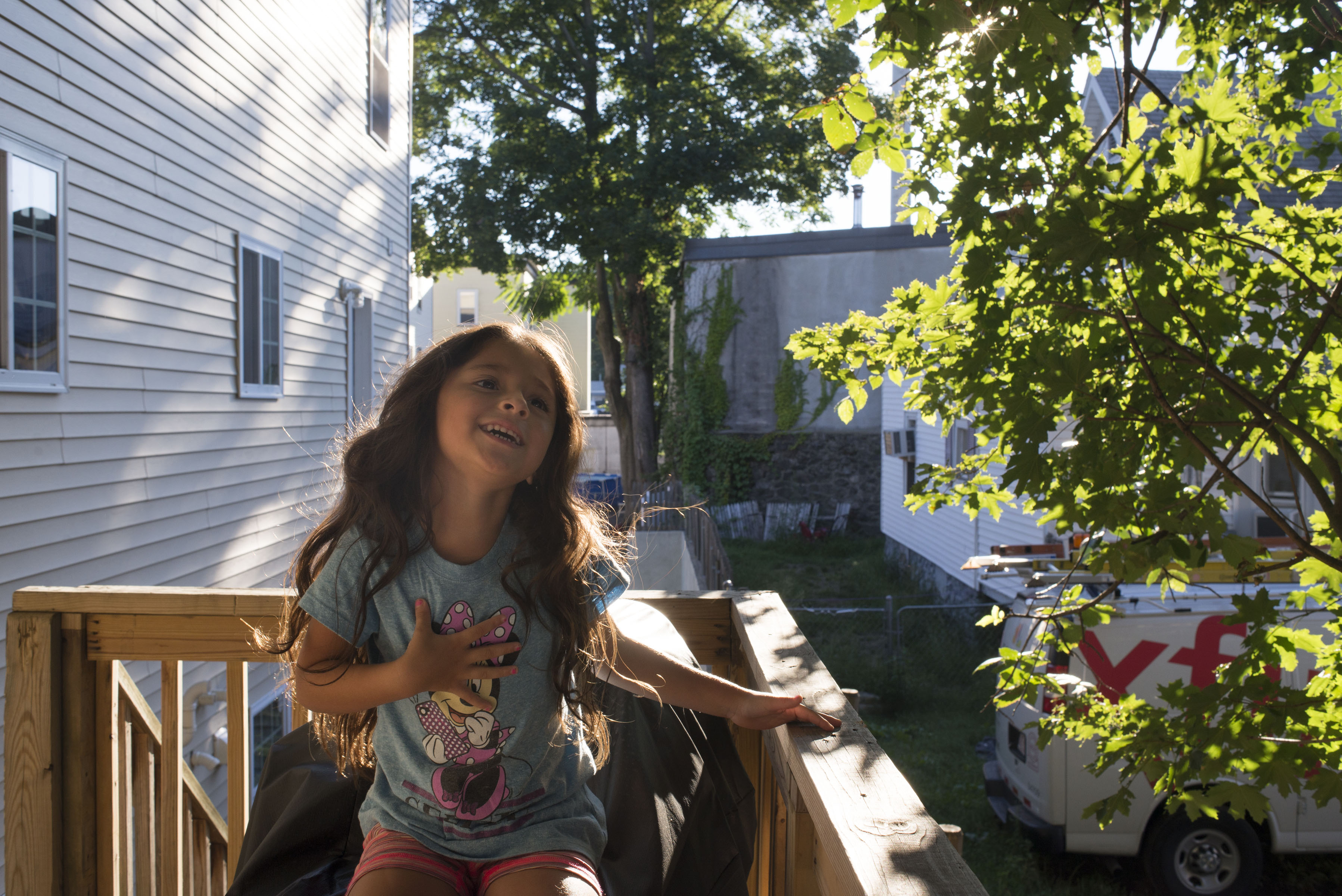 "My niece, Rubi, 5, sings on our deck in our home in Lawrence, Massachusetts. ""When I was just a little girl, I asked my mother, 'what will I be? Will I be pretty? Will I be rich?' Here's what she said to me, 'Que sera, sera' – whatever will be, will be the future is not ours to see. 'que sera, sera, 'what will be, will be."""