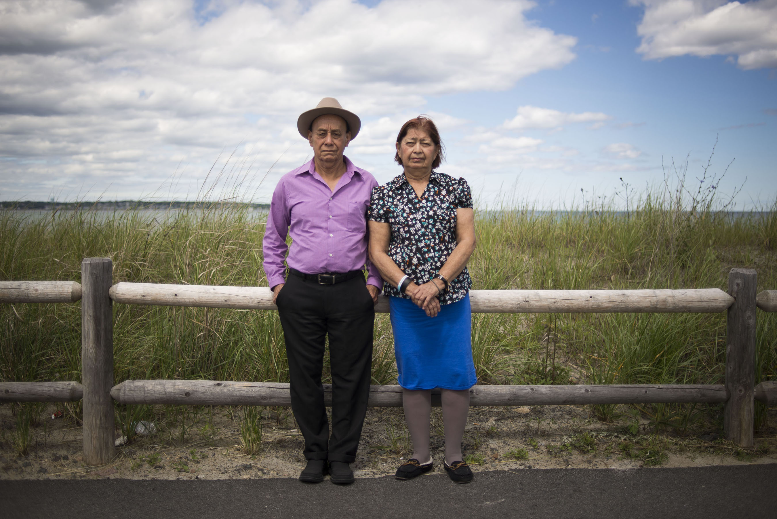 "During my grandparents' visit from El Salvador, they asked me to take their portrait in Nahant, Massachusetts. In my grandmother's words, ""I want you to take our photo so that, when we die, you can hang a life-size photo of the both of us in your home, just like the paintings in people's homes."" (Photo by Iaritza Menjivar/GroundTruth)"