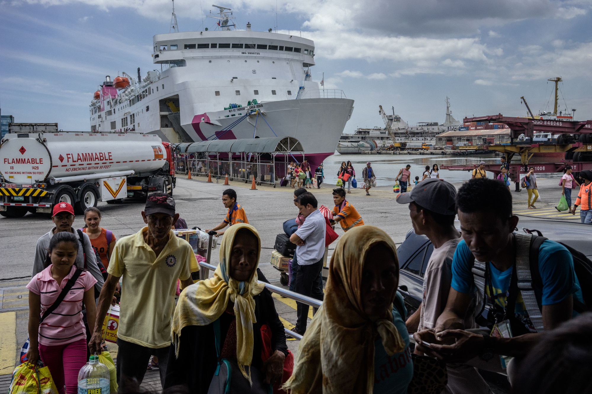 A boat arrives at the Manila port. Many girls on their way out of the province make their way through this boat. (Photo by Hannah Reyes Morales/GroundTruth)