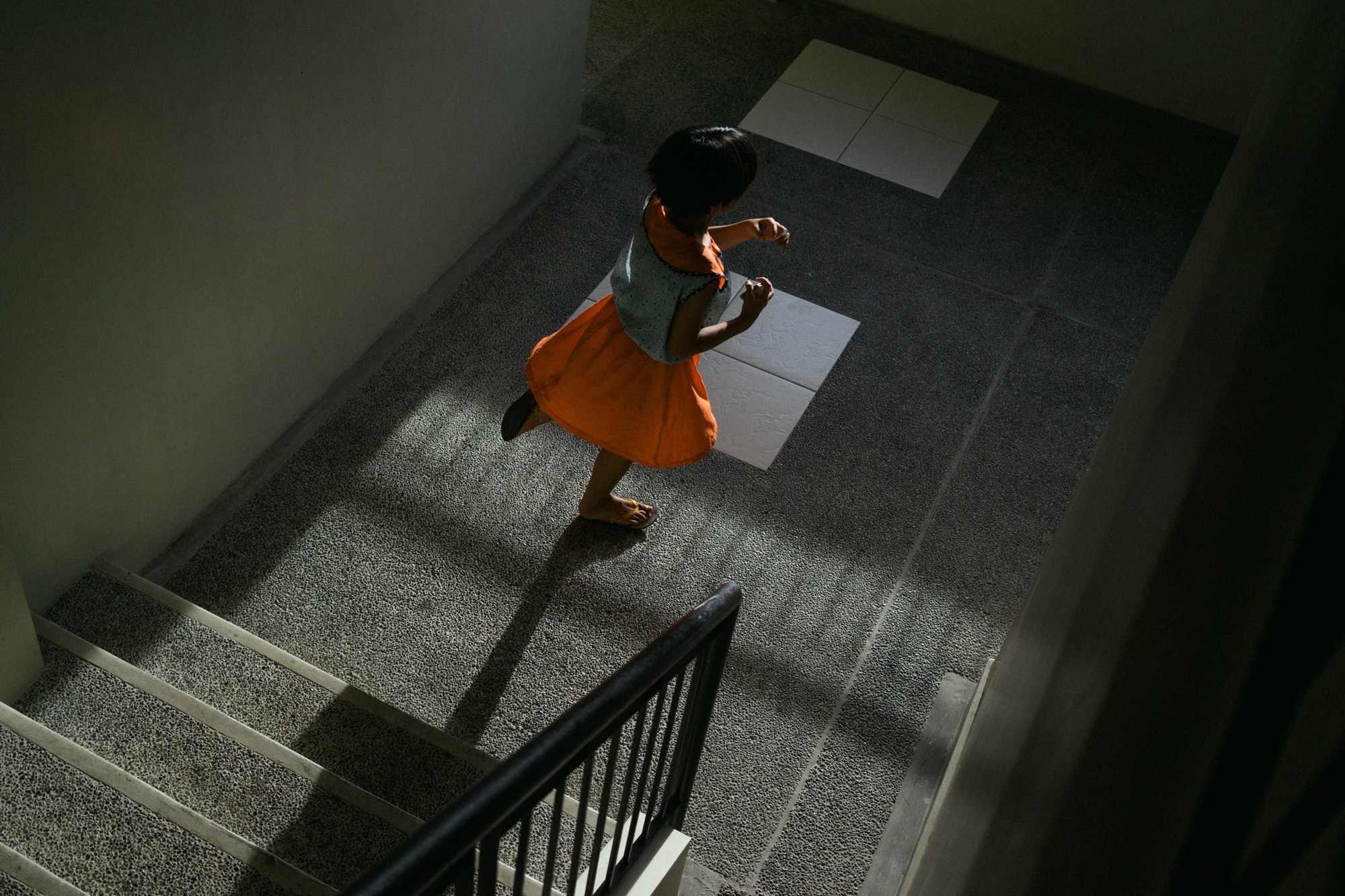 A 10-year-old child runs in a halfway house for sex trafficking victims outside of Manila. (Photo by Hannah Reyes Morales/GroundTruth)
