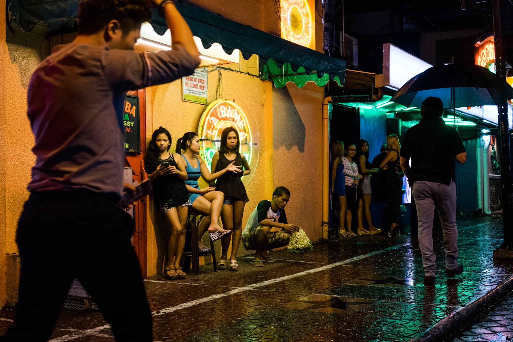 A scene from Fields Avenue, the red light district in Angeles City, notorious for its sex tourism. (Photo by Hannah Reyes Morales/GroundTruth)