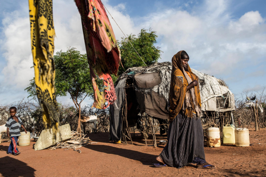 A woman walks through her family's compound in Dadaab refugee camp. (Photo by Nichole Sobecki/GroundTruth)