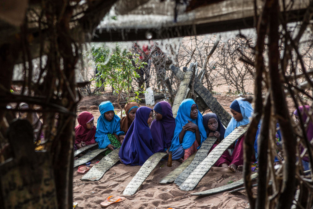 Somali children attend morning madrassa, or Islamic religious classes, in Dadaab refugee camp. (Photo by Nichole Sobecki/GroundTruth)