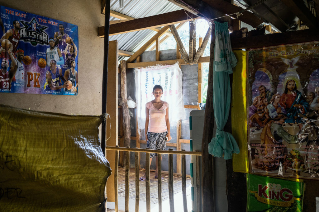 Tina was trafficked into a cyber sex den when she was 16 and pregnant with her child. Her hometown, Daram, is one of the most vulnerable to climate change due to frequent storms and poverty. (Photo by Hannah Reyes Morales/GroundTruth)