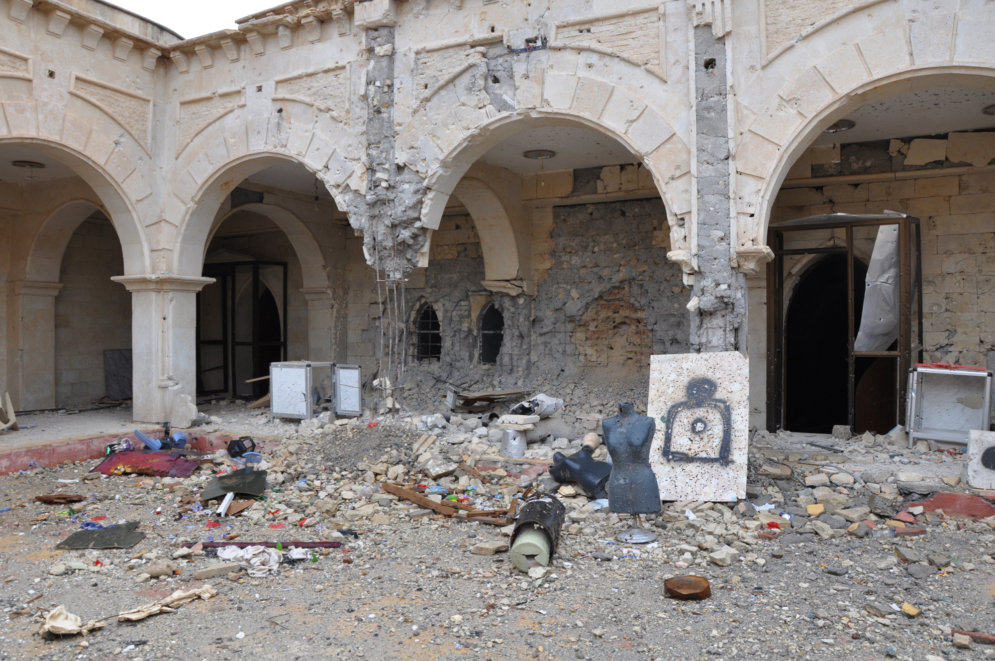 The destroyed courtyard of Qaraqoosh's Al-Taheera church, the largest in Iraq and one of the biggest in the Middle East. ISIS transformed the grounds into a shooting range with mannequins from a nearby clothing shop. (Photo by Lauren Bohn/GroundTruth)