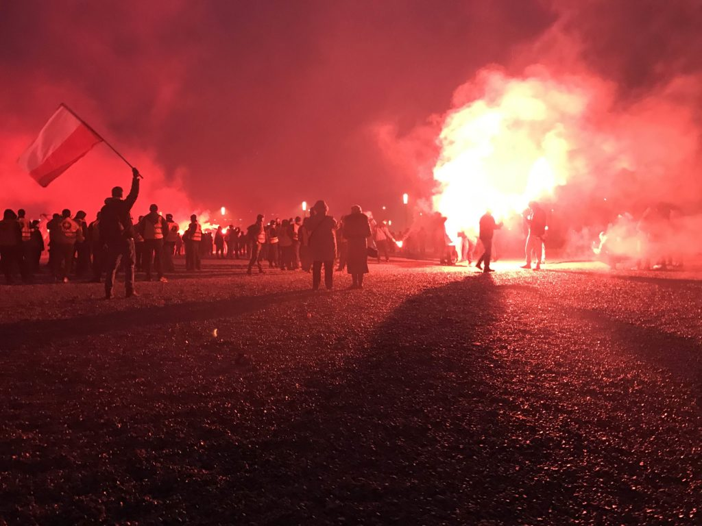 Snow mixed with ash at the nationalist rally in Warsaw on Nov. 11, where many young men wielded flares, flags and lit illegal fireworks. (Photo by Karolina Chorvath/GroundTruth)