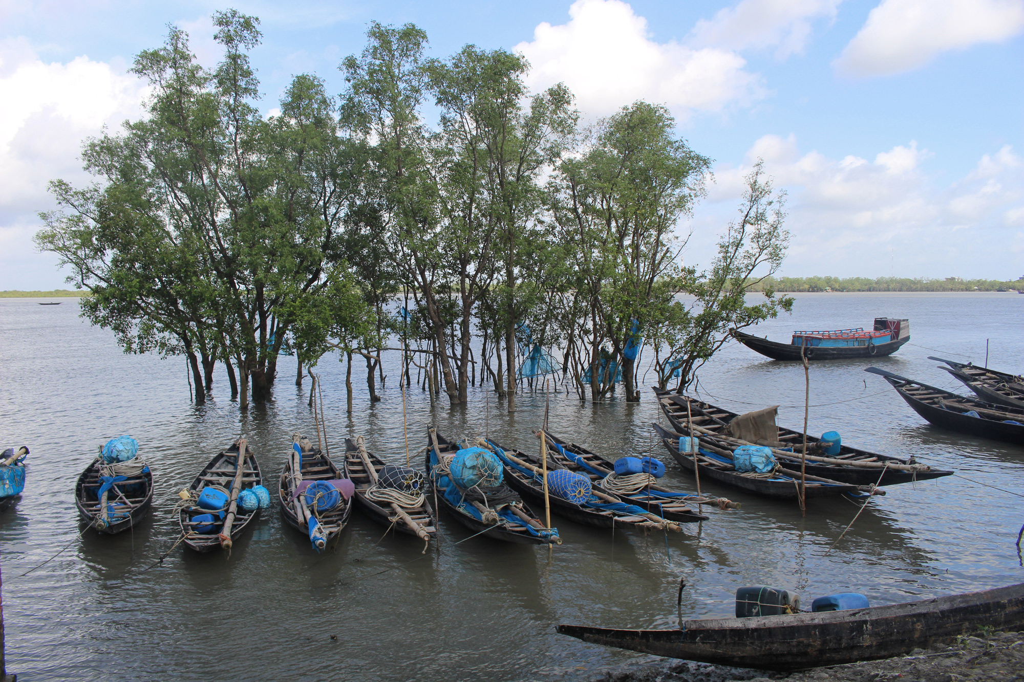 Boats line the shore in Bangladesh, where increasing water salinity leads to a water crisis. (Photo by Neha Thirani Bagri/GroundTruth)