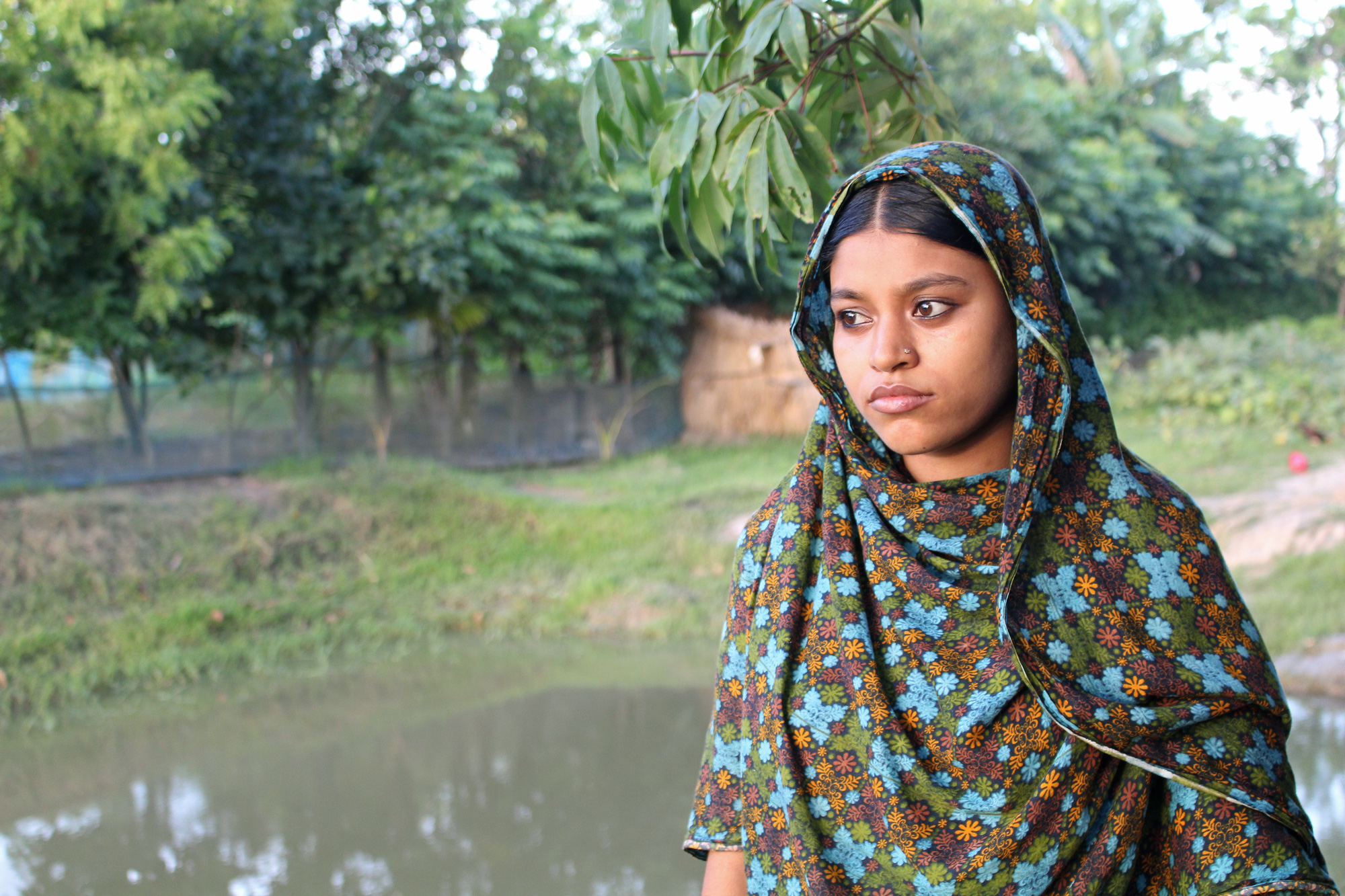 Shahina Begum, 18, moved to Kochukhali village when she got married at the age of 12. While her husband is away most of the year in Dhaka, she lives with his parents who keep strict tabs on her whereabouts. (Photo by Neha Thirani Bagri/GroundTruth)