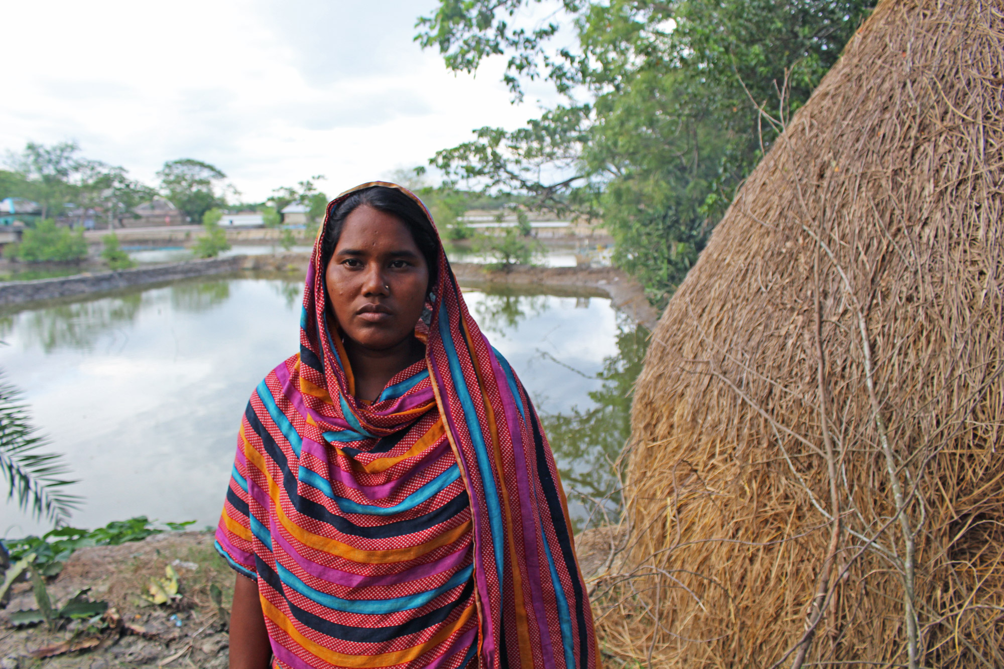 """The agriculture is not good here, the saline water comes from below in the soil. Some time after planting paddy, it becomes red and dies out,"" Romesa Khatun 27, said. (Photo by Neha Thirani Bagri/GroundTruth)"