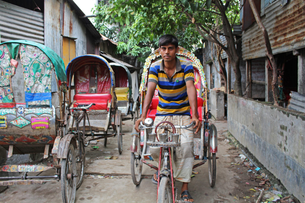 """Those who come to Dhaka are all poor, have no income,"" said Kabir Hossain. ""But those who are not poor, they choose to stay in the village. It is a better life there."" (Photo by Neha Thirani Bagri/GroundTruth)"