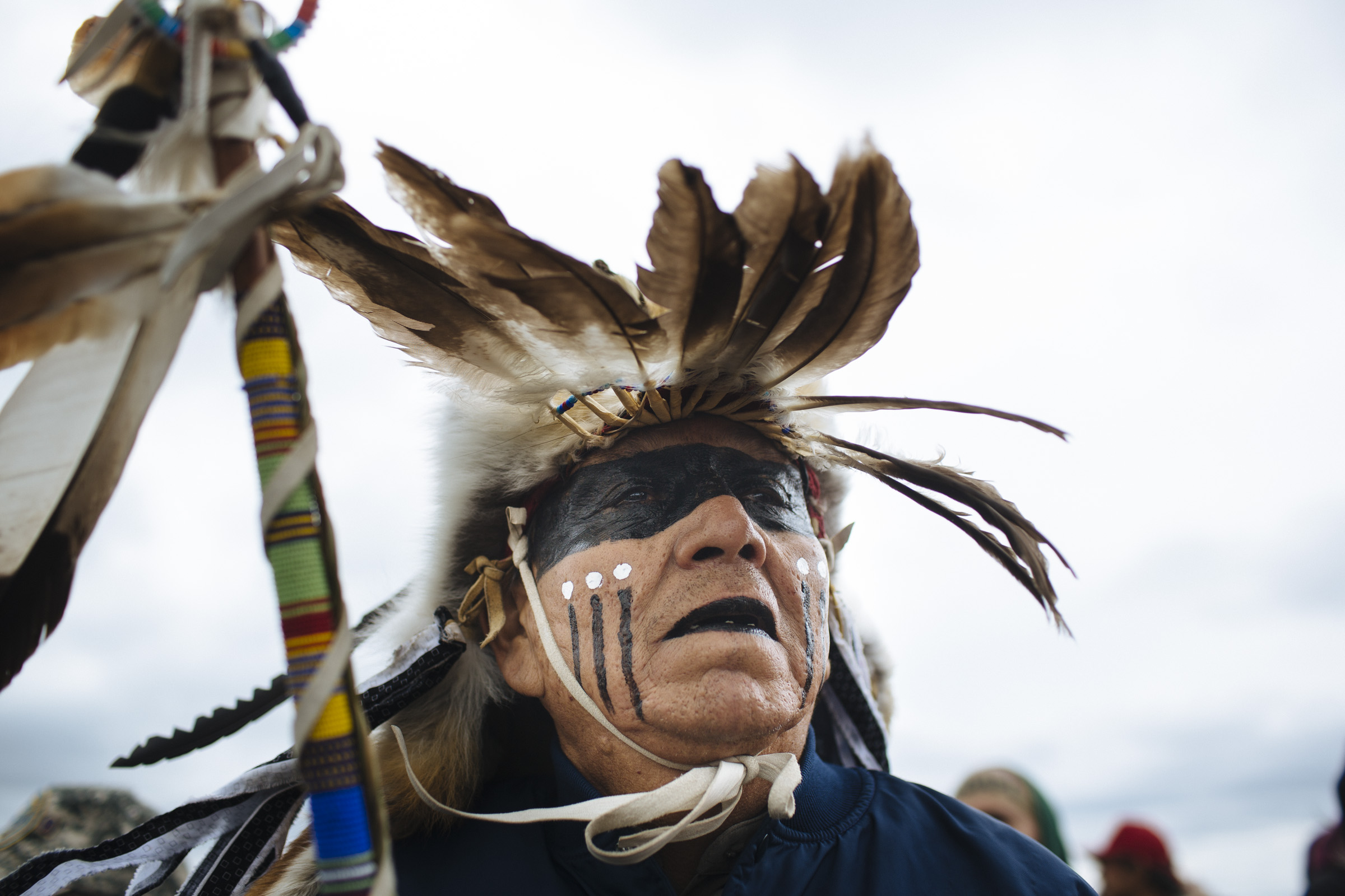 An unidentified man at the front of a protest march of over 700 water protectors on Friday, Sept., 2016. The march covered the 2 miles between the Oceti Sakowin Camp and a sacred burial site, which is slated to be destroyed by the Dakota Access Pipeline. (Photo by Angus Mordant/Groundtruth)