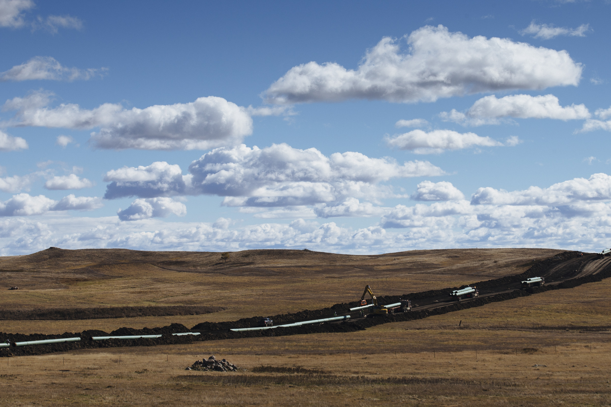 A rock formation, believed to be a sacred cairn signifying a burial site, is seen in front of Dakota Access Pipeline construction on Tuesday, Oct. 18, 2016. The Standing Rock Sioux Tribe claims that the 1,172-mile underground crude oil pipeline will disturb sacred sites and has the potential to contaminate the Missouri River. (Photo by Angus Mordant/Groundtruth)