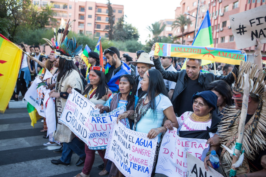 People participate in a climate march in Marrakech during the U.N. climate conference, COP22. (Photo by David Tong/Flickr)