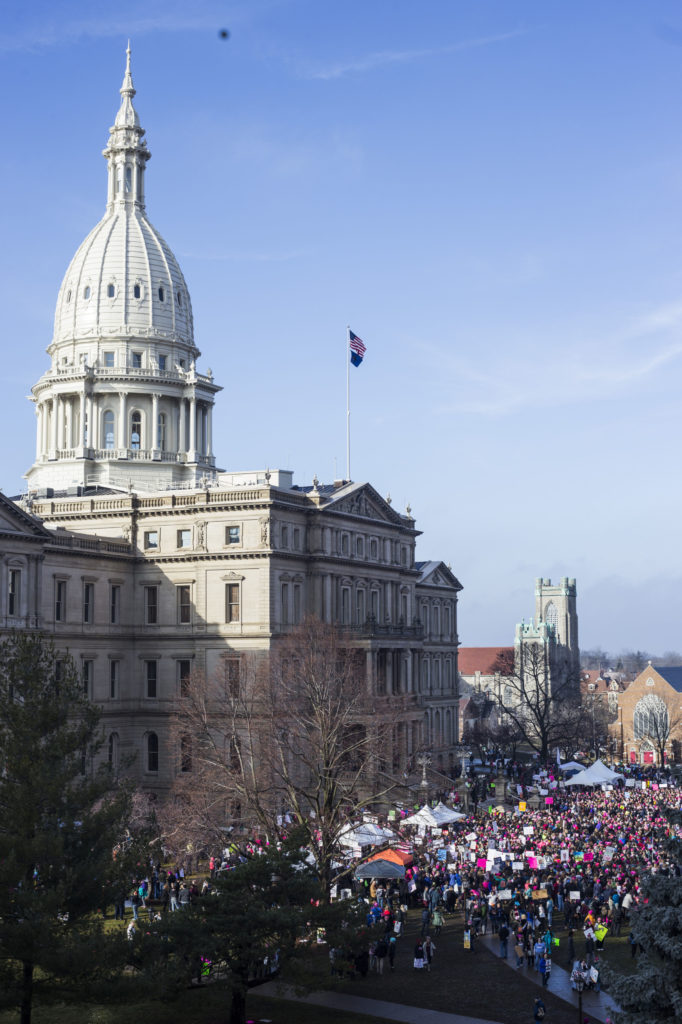 Thousands gather outside of the Michigan State Capitol Building for the Women's March on Lansing in Lansing, Mich., on Saturday, January 21, 2017. (Photo by Brittany Greeson/GroundTruth)
