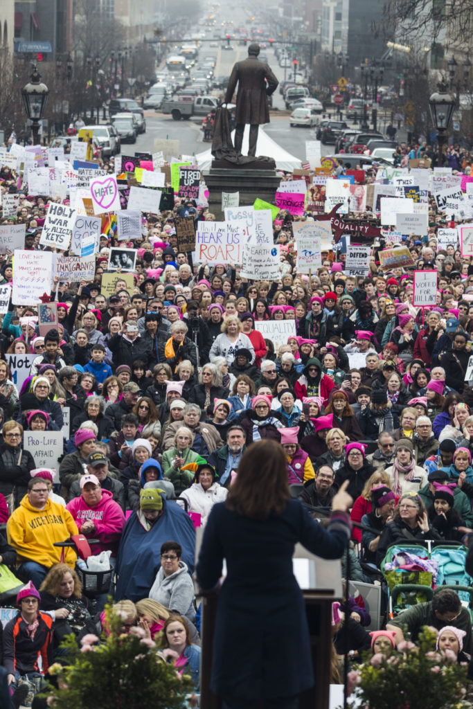 Michigan gubernatorial candidate Gretchen Whitmer speaks to a crowd of thousands outside of the Michigan State Capitol Building for the Women's March on Lansing in Lansing, Mich., on Saturday, January 21, 2017. (Photo by Brittany Greeson/GroundTruth)