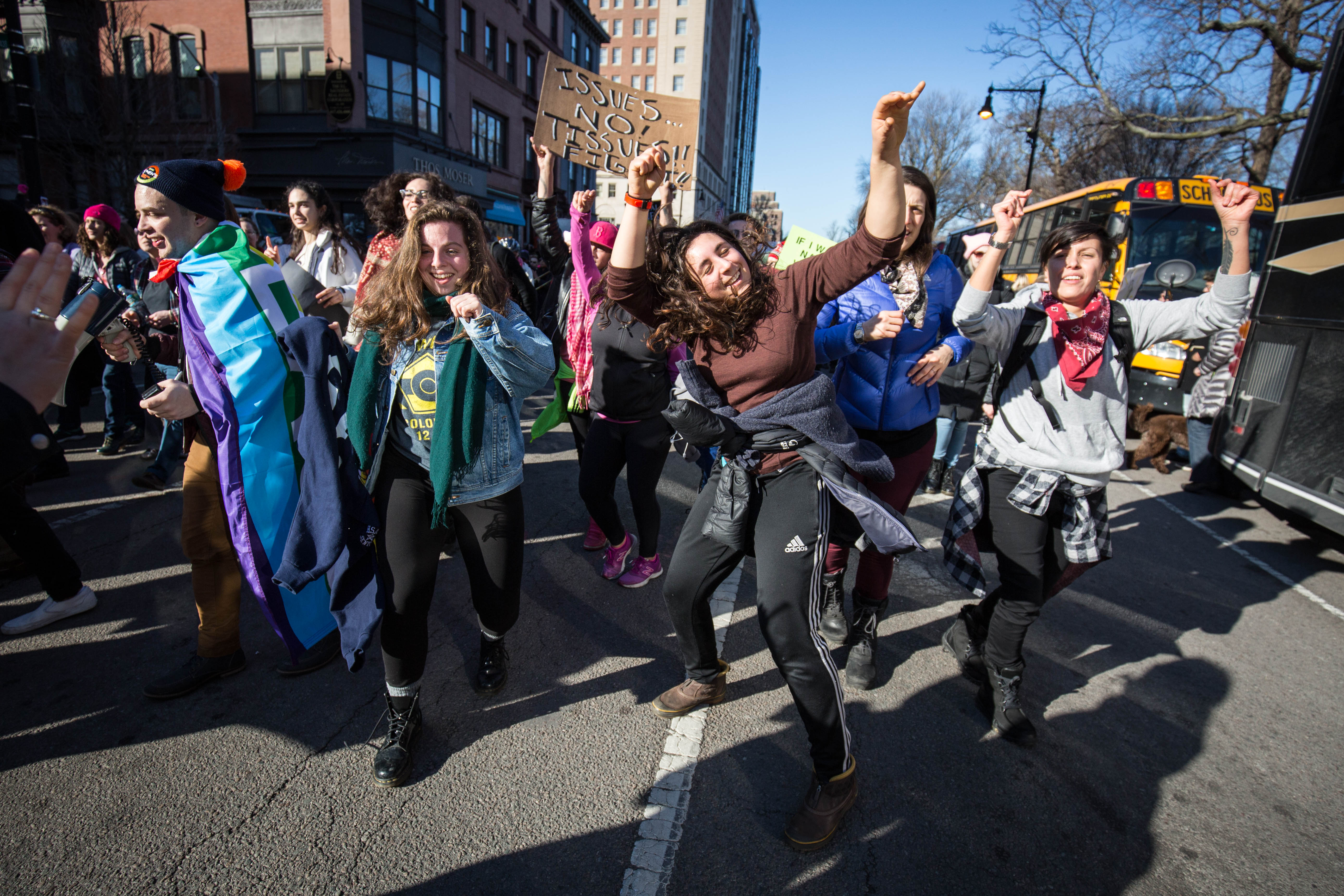 Marchers follow a band and dance in the streets during the Boston Women's March on Jan. 21, 2017 (Photo by Alastair Pike).
