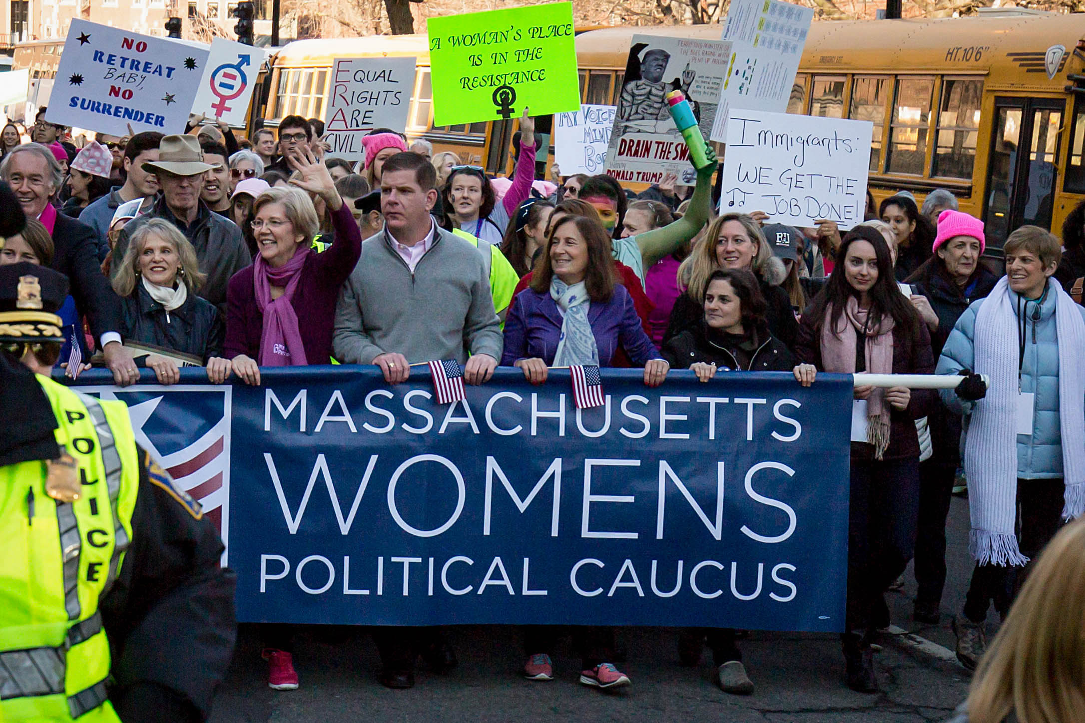 Boston Mayor Marty Walsh and Sen. Elizabeth Warren march with women holding up a sign for the Massachusetts Womens Political Caucus on Jan. 21, 2017. (Photo by Alastair Pike)