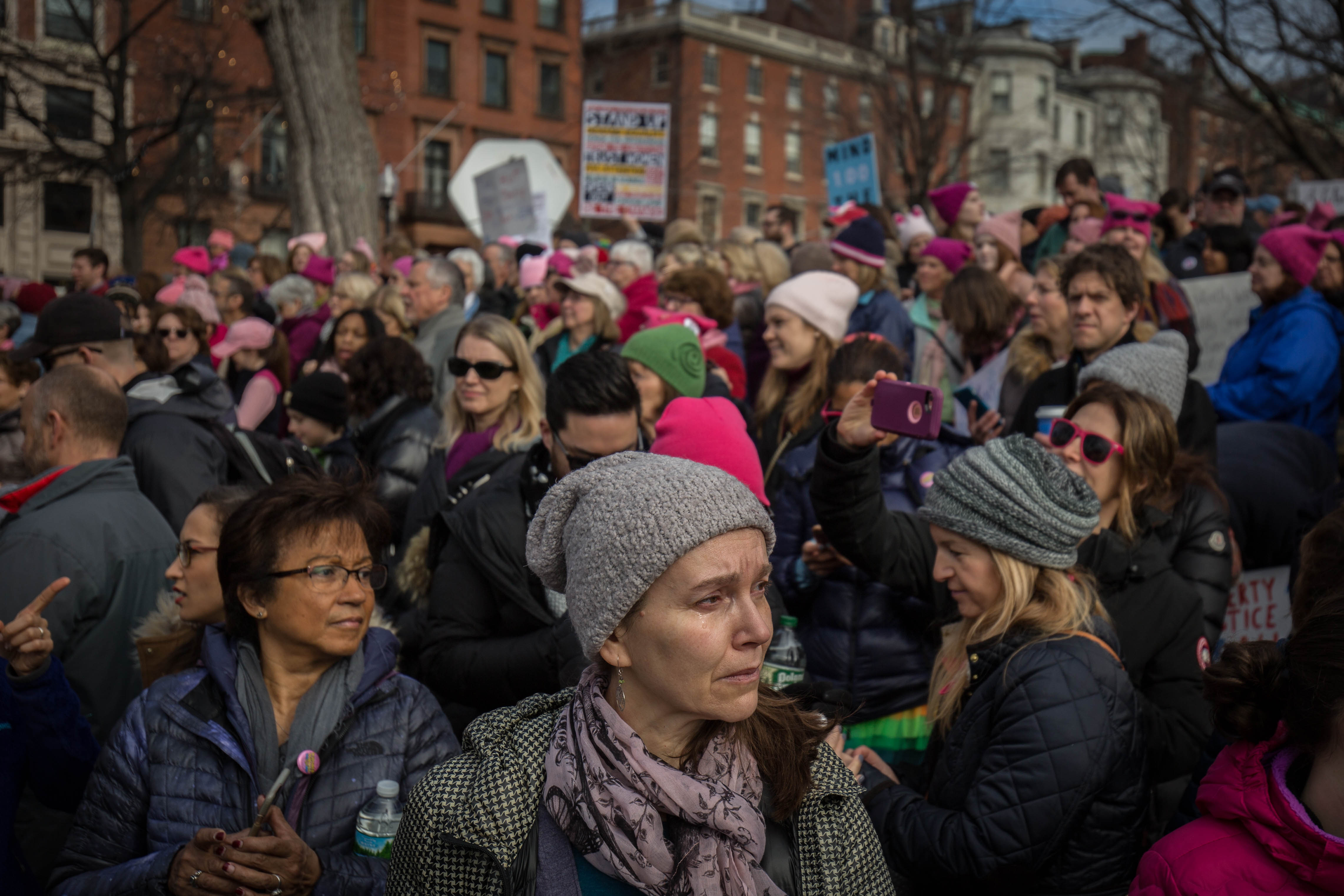 "A woman sheds a tear as the song, ""America the Beautiful: Together We Stand"" plays in the Boston Common during the Boston Women's March on Jan. 21, 2017. (Photo by Alastair J. Pike/GroundTruth)"