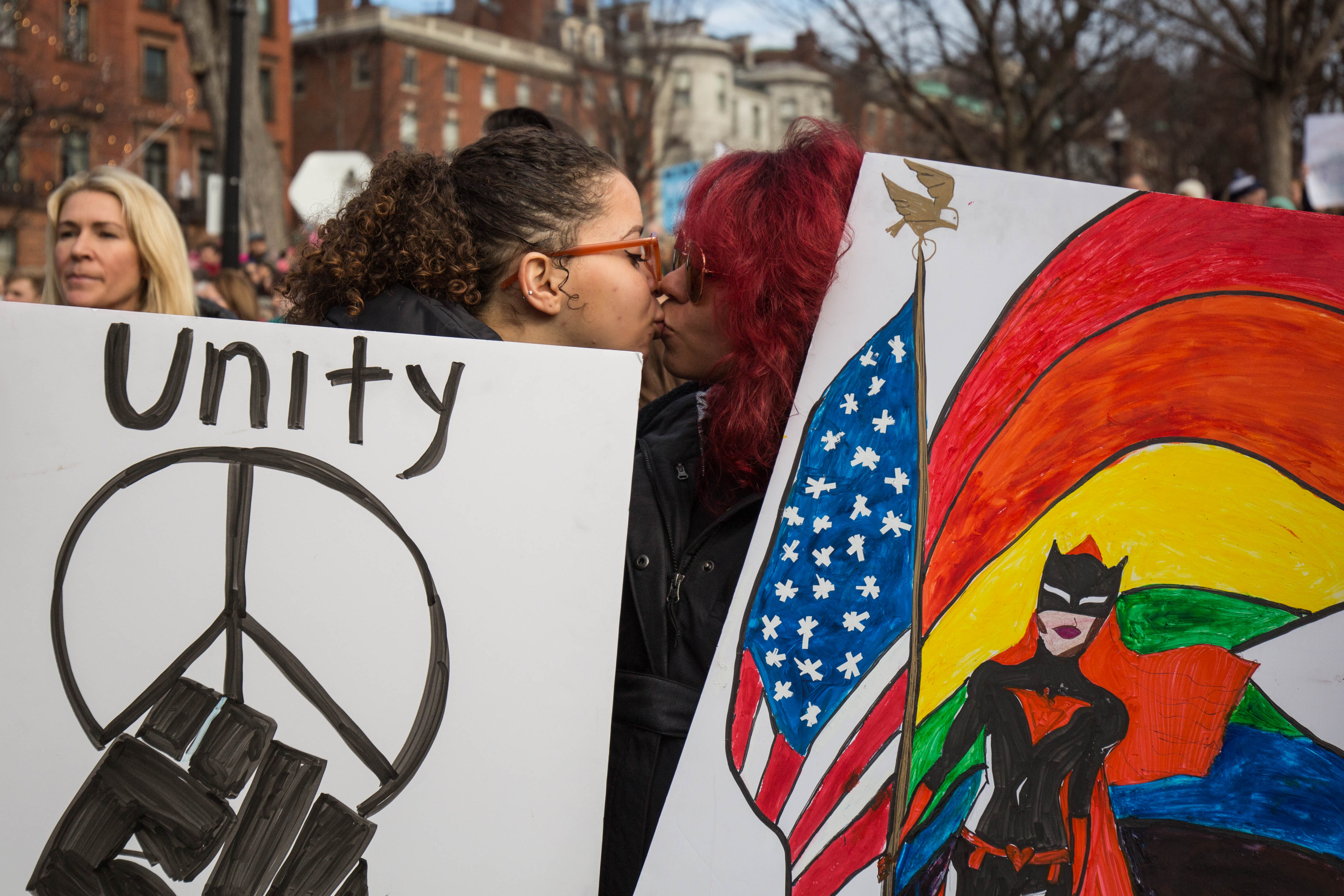 Audrey Guerrero, 25, of Boston, and Angie Egea, 27, of Colombia, kiss during the Boston Women's March on Jan. 21, 2017. (Photo by Alastair Pike)