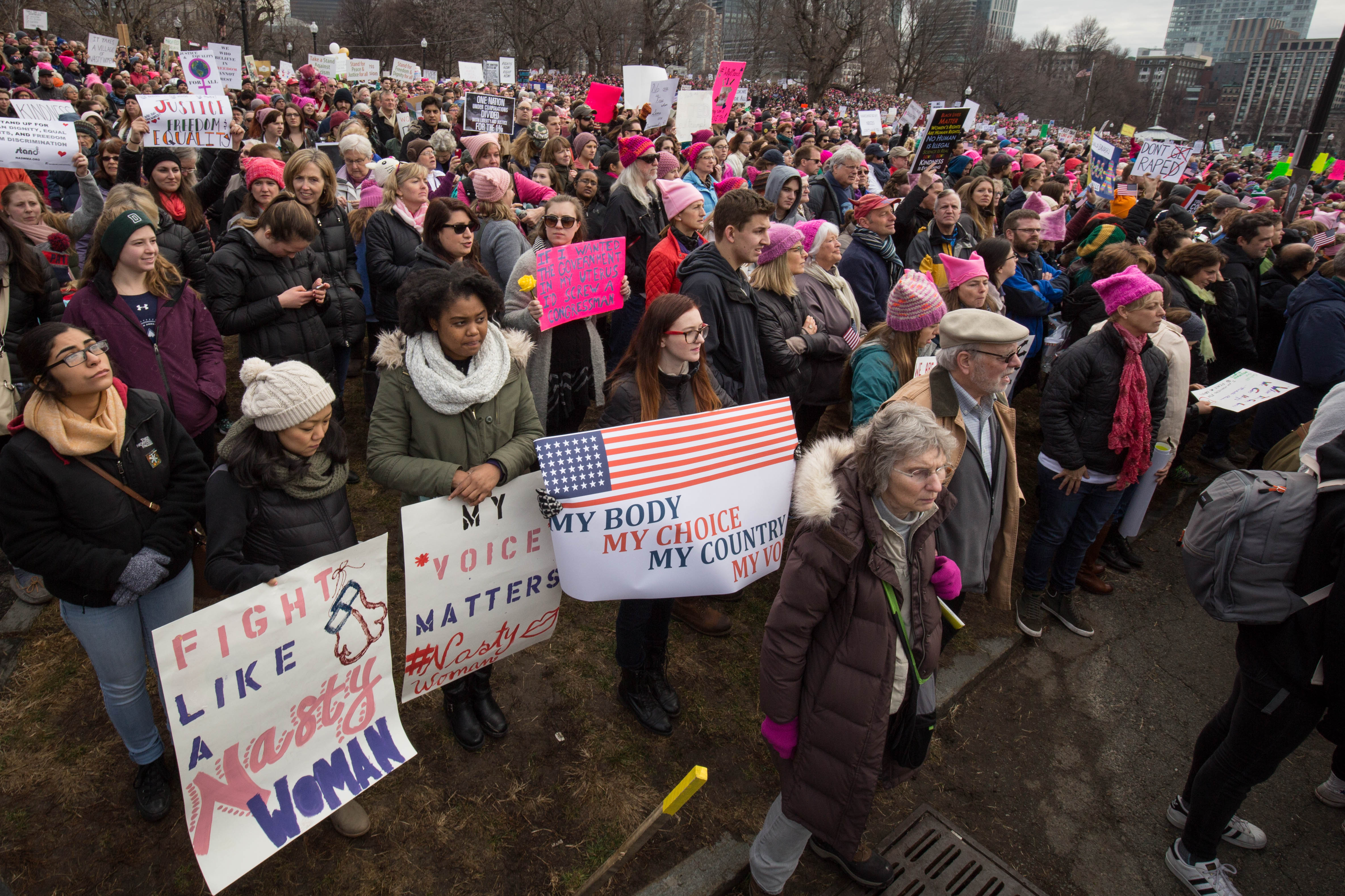 Kristen Coogan, 24, of Marlboro, Mass., and Jessica Pierre, 24, of Somerville, Mass., look on during the Boston Women's March on Jan. 21, 2017. (Photo by Alastair Pike)