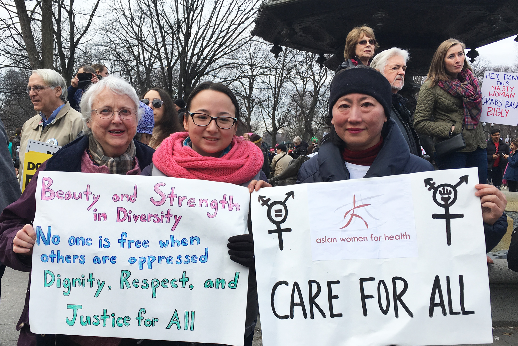 (Left to right) Claris Bergman, Samantha Bergman and Chien-Chi Huang, all part of the same family, explain why they march in Boston on Jan. 21, 2017. (Photo by Kelly Kasulis/GroundTruth)