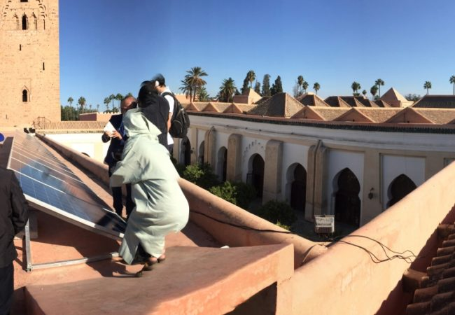 Marrakech's Koutoubia mosque has soaked up the Moroccan sun for nearly 900 years. Now it also puts those rays to work generating clean electricity. (Photo by Chris Bentley/GroundTruth)