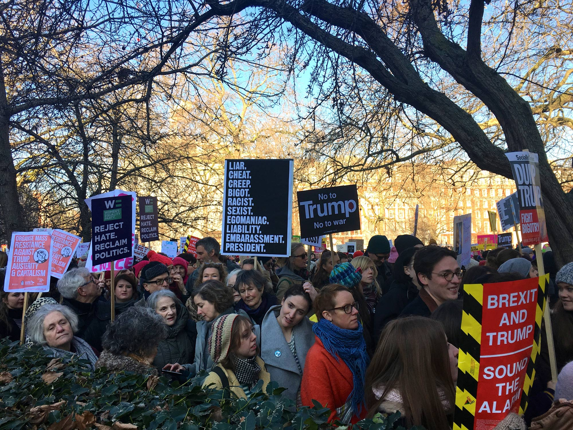 Protestors hold up signs with a list of complaints against U.S. President Trump in London on Jan. 21, 2017. (Photo by Devi Lockwood/GroundTruth)
