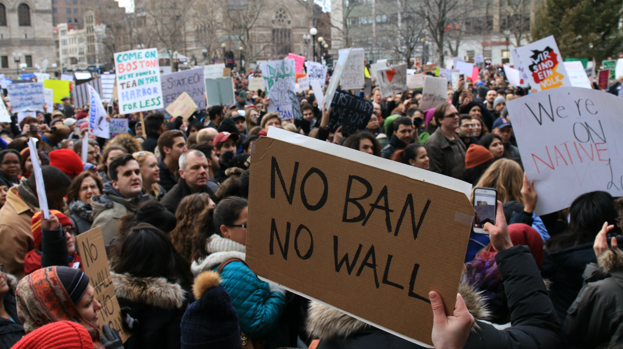 """The debate on immigration has become extremely polarized. How do you write stories that say something new? Find people who've never been asked about their experiences. Pictured: protesters in Boston's Copley Square on Jan. 29, 2017, after President Donald Trump signed an executive order known as the """"Muslim ban."""" (Photo by Giulia Afiune/GroundTruth)"""