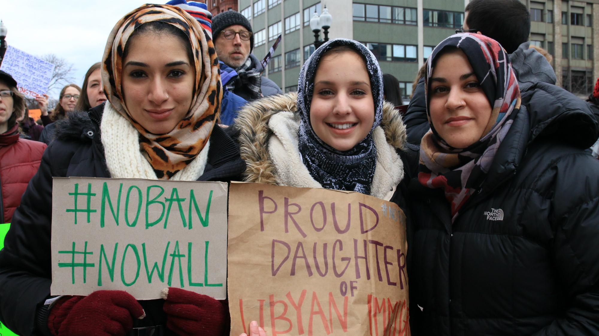 Jasmin Riad (left), Noor Traina and Zara Majidi protested against President Donald Trump's executive order in Boston's Copley Square on Jan. 29, 2017. (Photo by Giulia Afiune/GroundTruth)