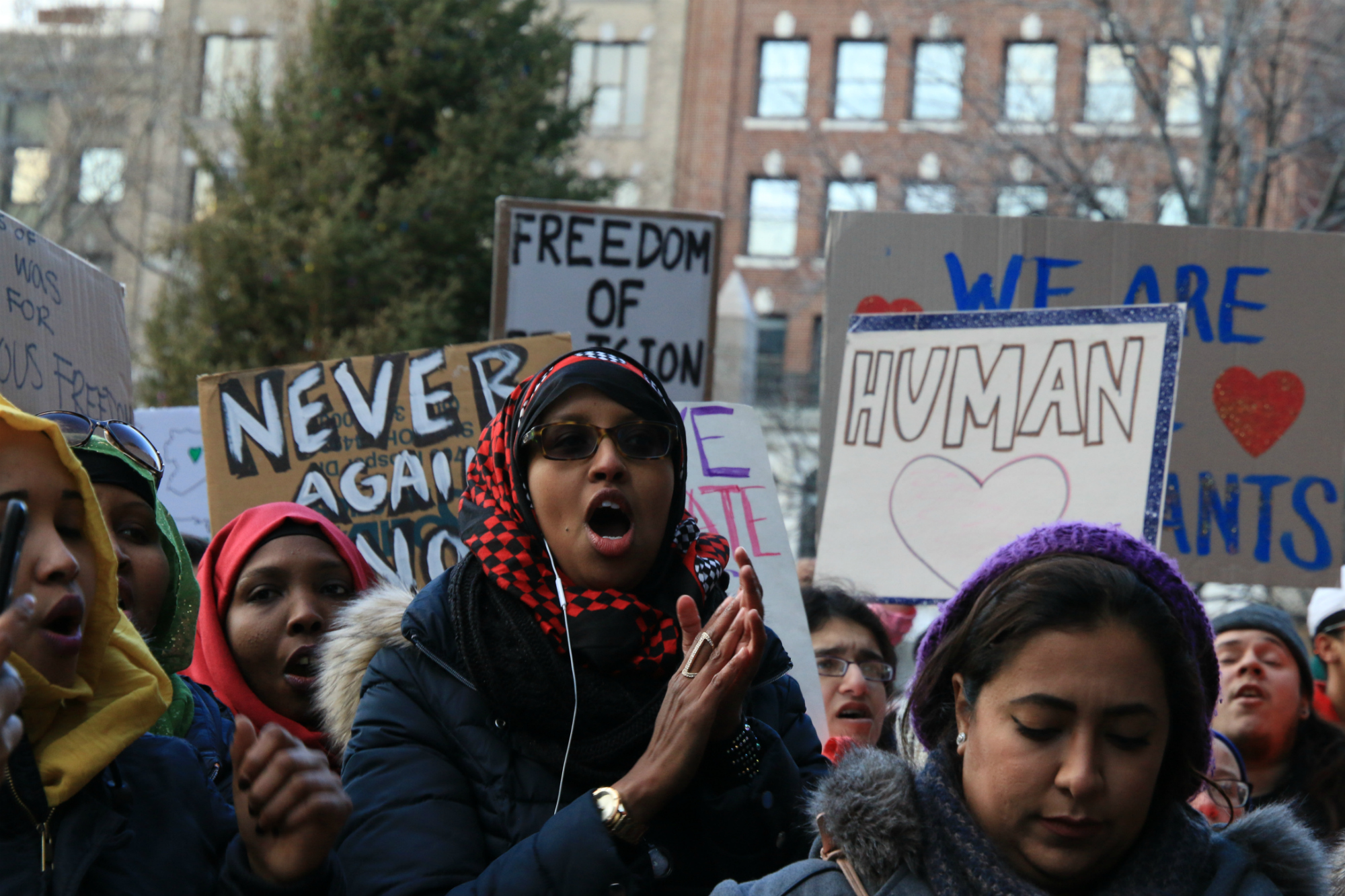 Demonstrators are pictured in Boston's Copley Square on Jan. 29, 2017, protesting President Donald Trump's executive order banning immigration from seven majority-Muslim countries. (Photo by Giulia Afiune/GroundTruth)