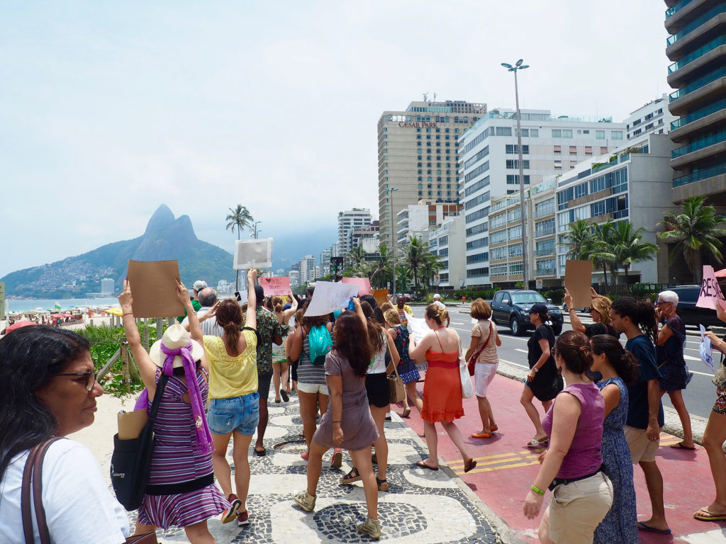 Demonstrators march along the beach during Rio's Women's March. (Photo by Catherine Osborn/GroundTruth)