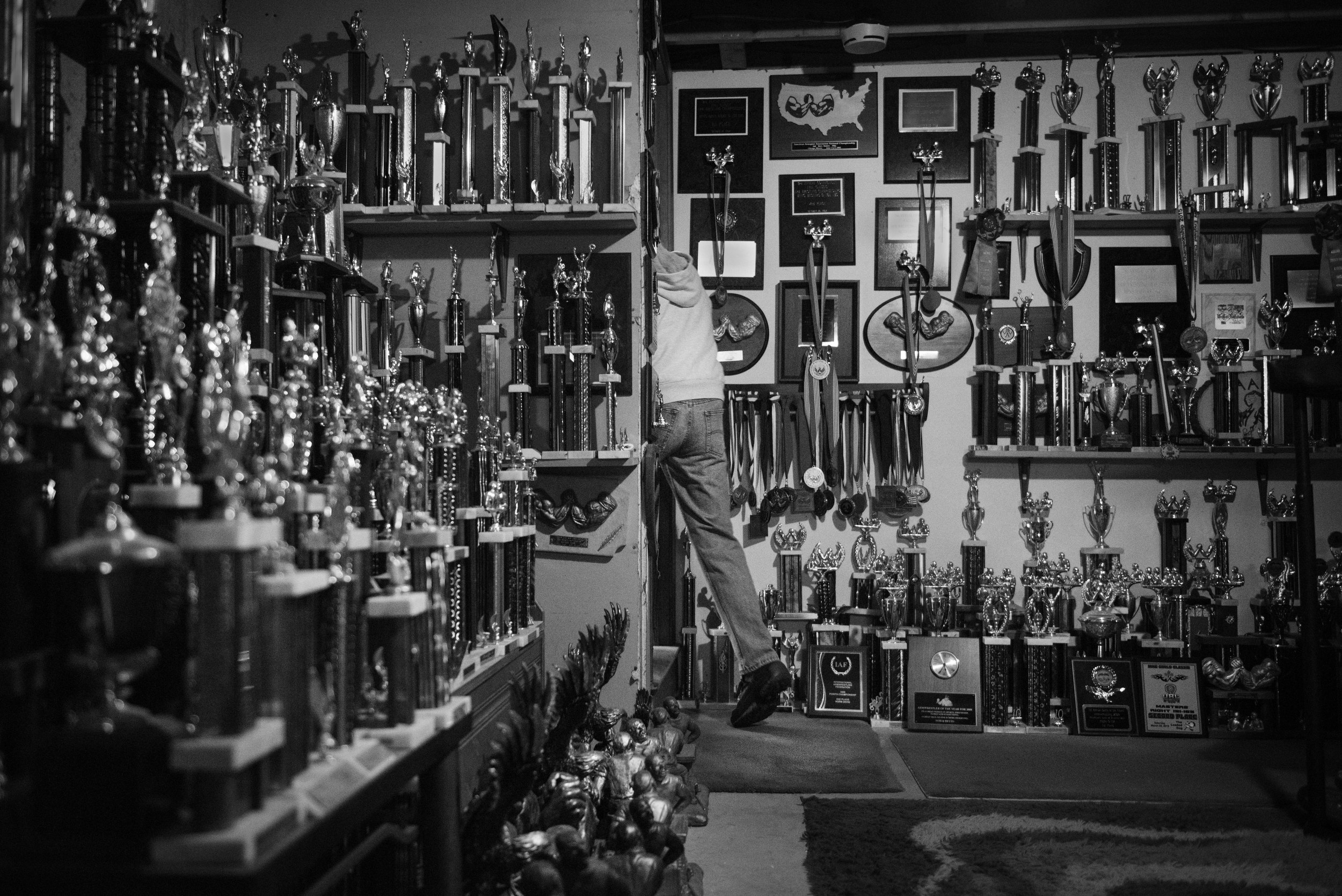 Devio has won countless tournaments during his 40 years in the sport. He has started giving away more than 500 trophies to friends and family members who come to visit. March 12, 2016. (Photo by Adam Glanzman/GroundTruth).