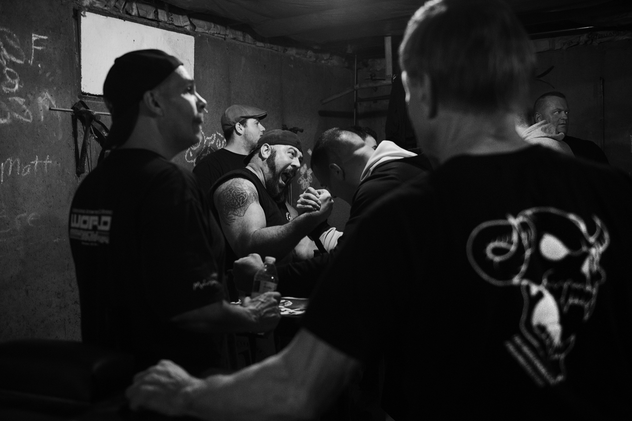Devio watches other arm wrestler practice at Fitzsimmons house on April 7, 2016. (Photo by Adam Glanzman/GroundTruth)
