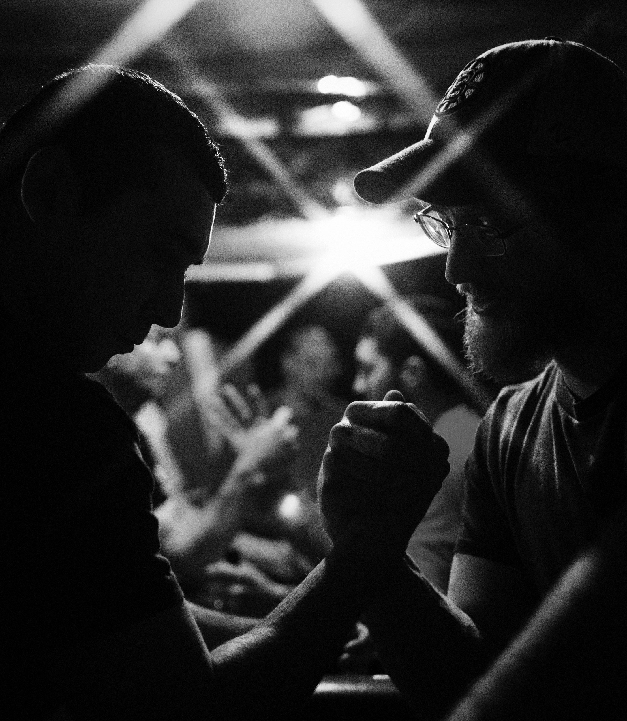 Every Thursday night, a dozen or more arm wrestlers from across Massachusetts gather in a basement in West Bridgewater to practice their arm wrestling techniques. March 3, 2016. (Photo by Adam Glanzman/GroundTruth)