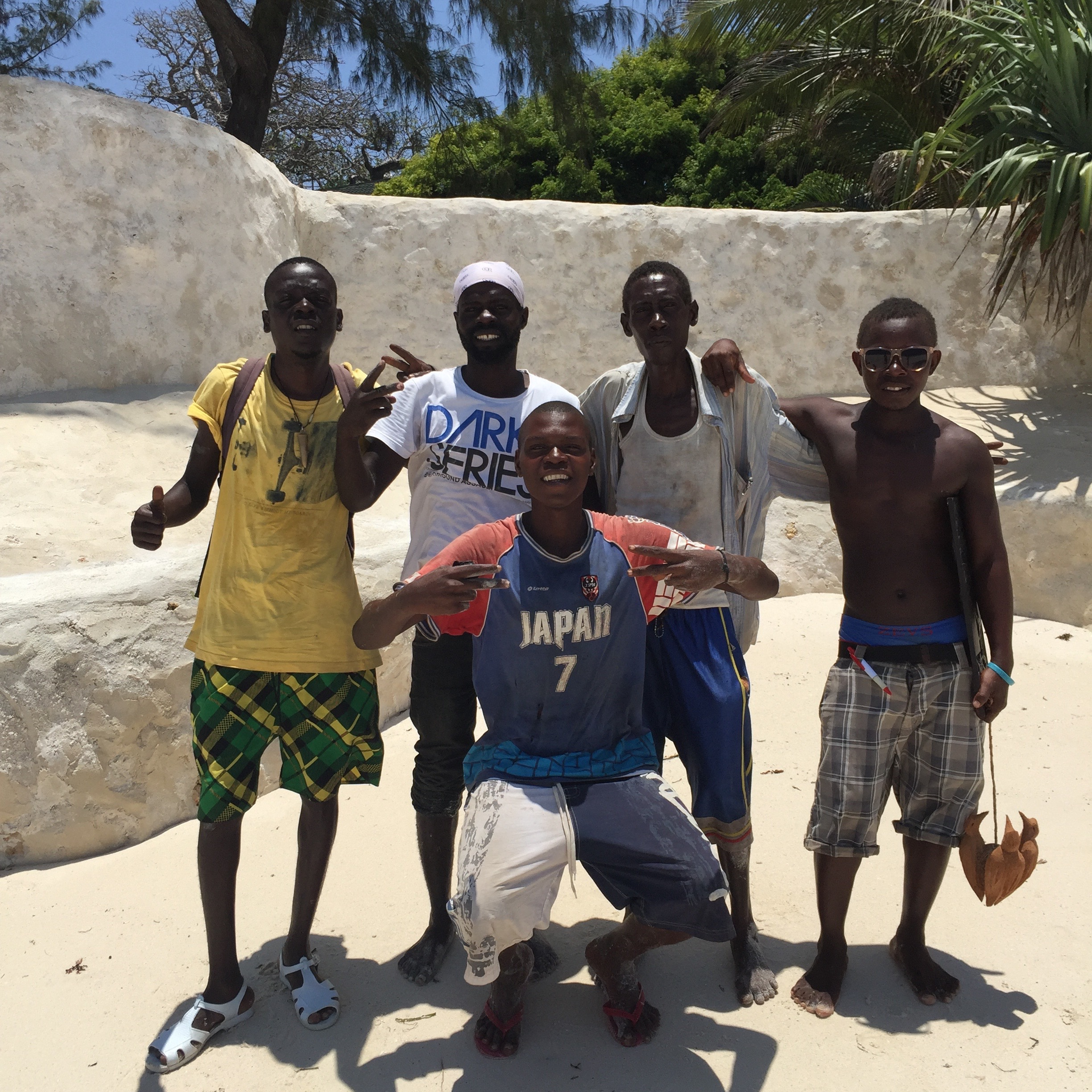 Five Sea Safari crew members pose for a group photo in Diana Beach, Kenya. (Photo by Kevin Grant/GroundTruth)