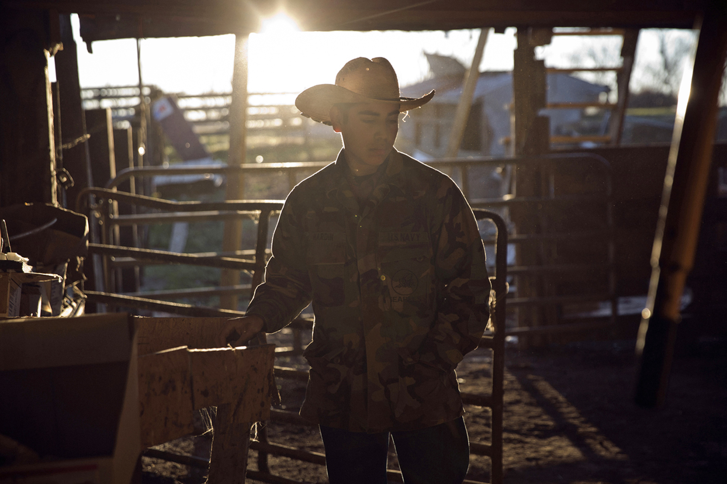 "Francisco Espinoza, 19, poses for a portrait on a ranch in Bowling Green, Kentucky, in December 2015. ""There are many differences between Americans and Hispanics. I mostly hang out with Hispanics that are born in America because we understand each other. But the Americans are nice, too, like my American girlfriend,"" Espinoza said. (Photo by Betina Garcia/GroundTruth)"