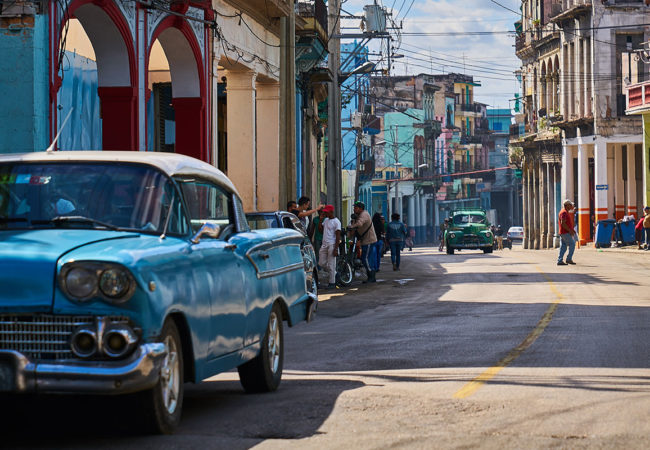 People walk along a streets in Havana, Cuba. Diplomatic relations between Cuba and the United States were re-established during Barack Obama's presidency – but now, with Donald Trump in office, the future of these diplomatic relations are somewhat unclear. (Photo by Pedro Szekely/Flickr)