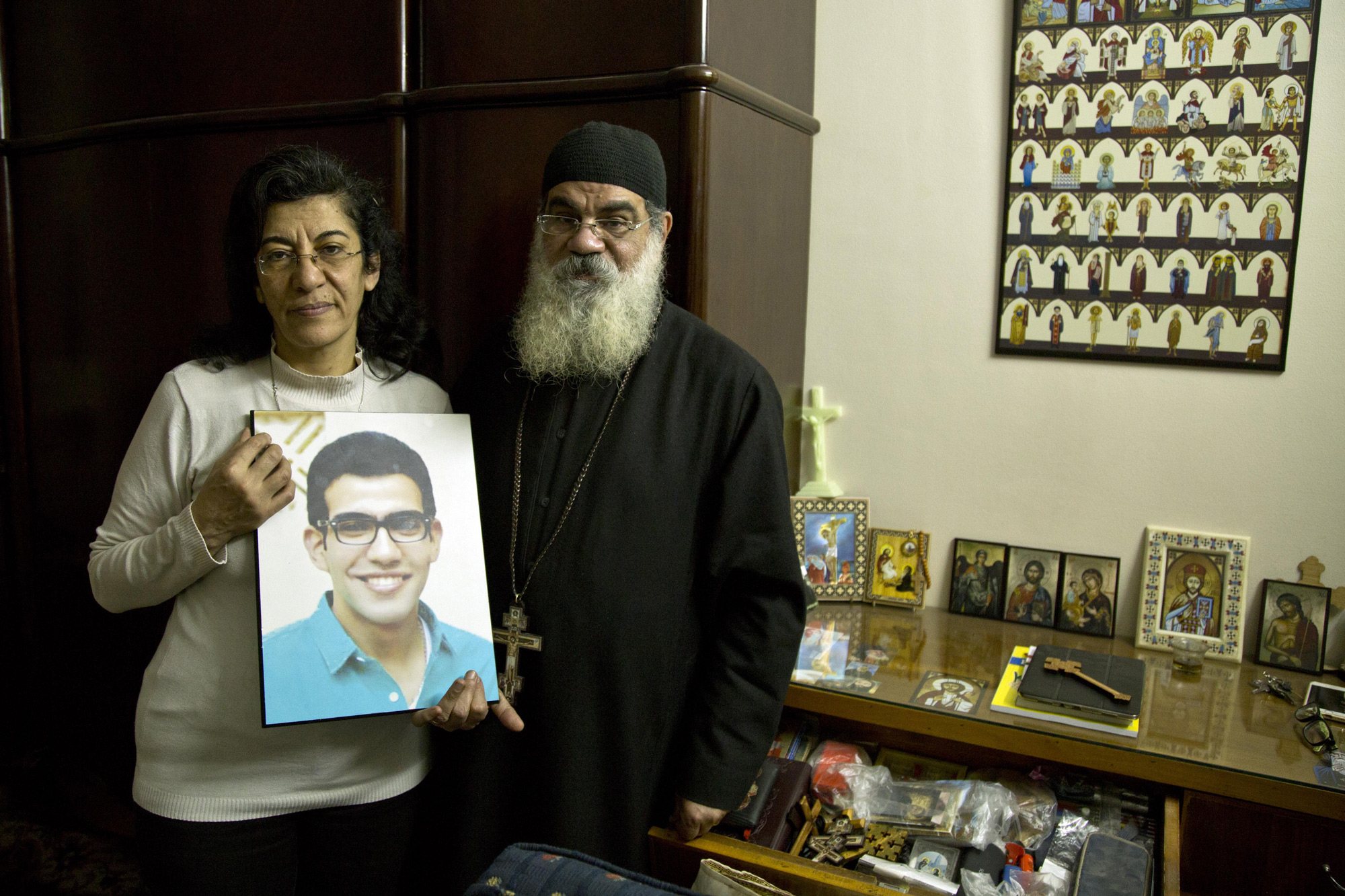 Priest Danial and his wife stand in the room of their son, Beshoy, who died during the suicide bombing in St. George Church in Egypt on Wednesday, April 12, 2017. (Photo by Roger Anis/GroundTruth)