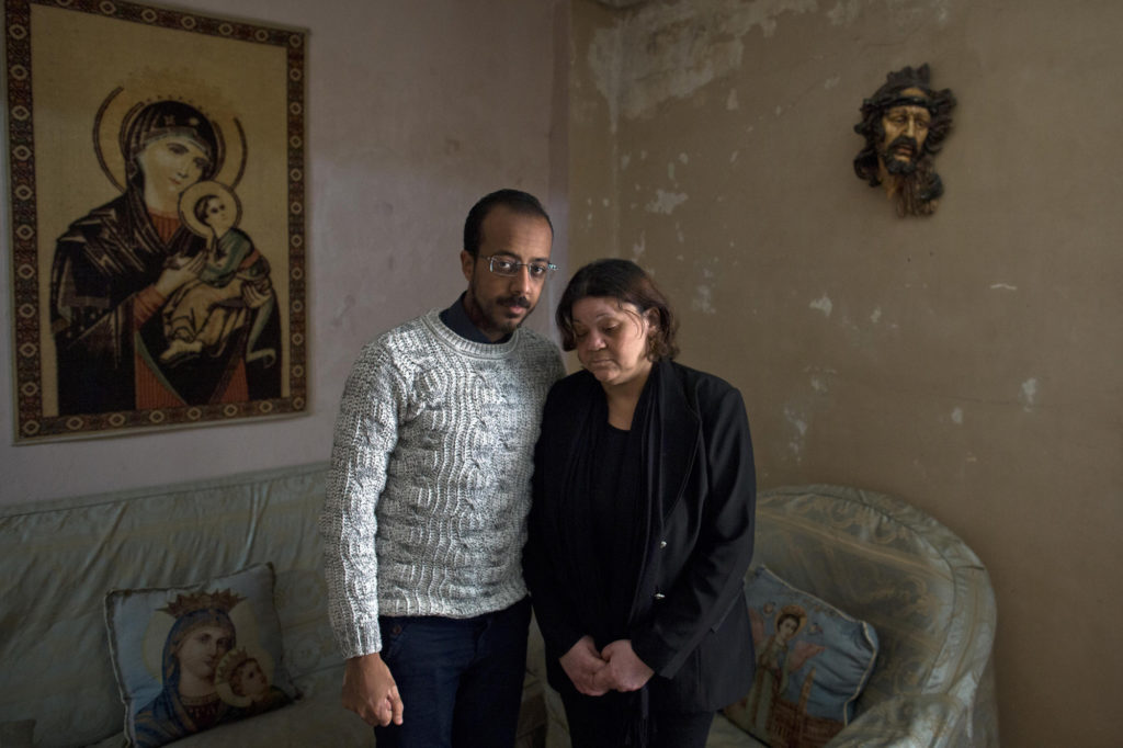 The wife and son of Faheem Nassim, who died during a suicide bombing in St. Markos Church in Egypt. (Photo by Roger Anis/GroundTruth)