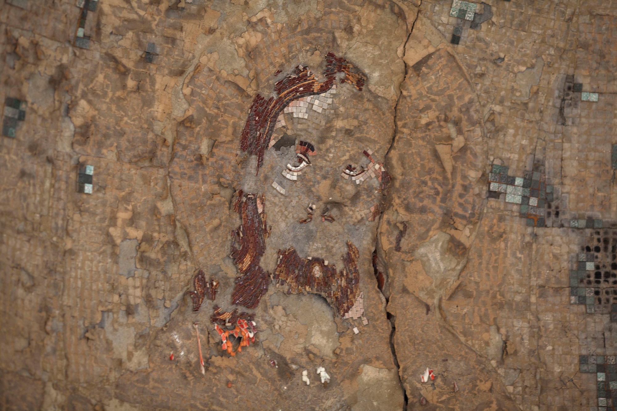 A damaged mosaic of Jesus inside the St. Mousa church in Minya, Egypt. In 2013, the temple was one of the dozens of churches, businesses and homes that were burned during a surge of violence against Egypt's Christian minority.(Photo by Heidi Levine/Sipa Press).