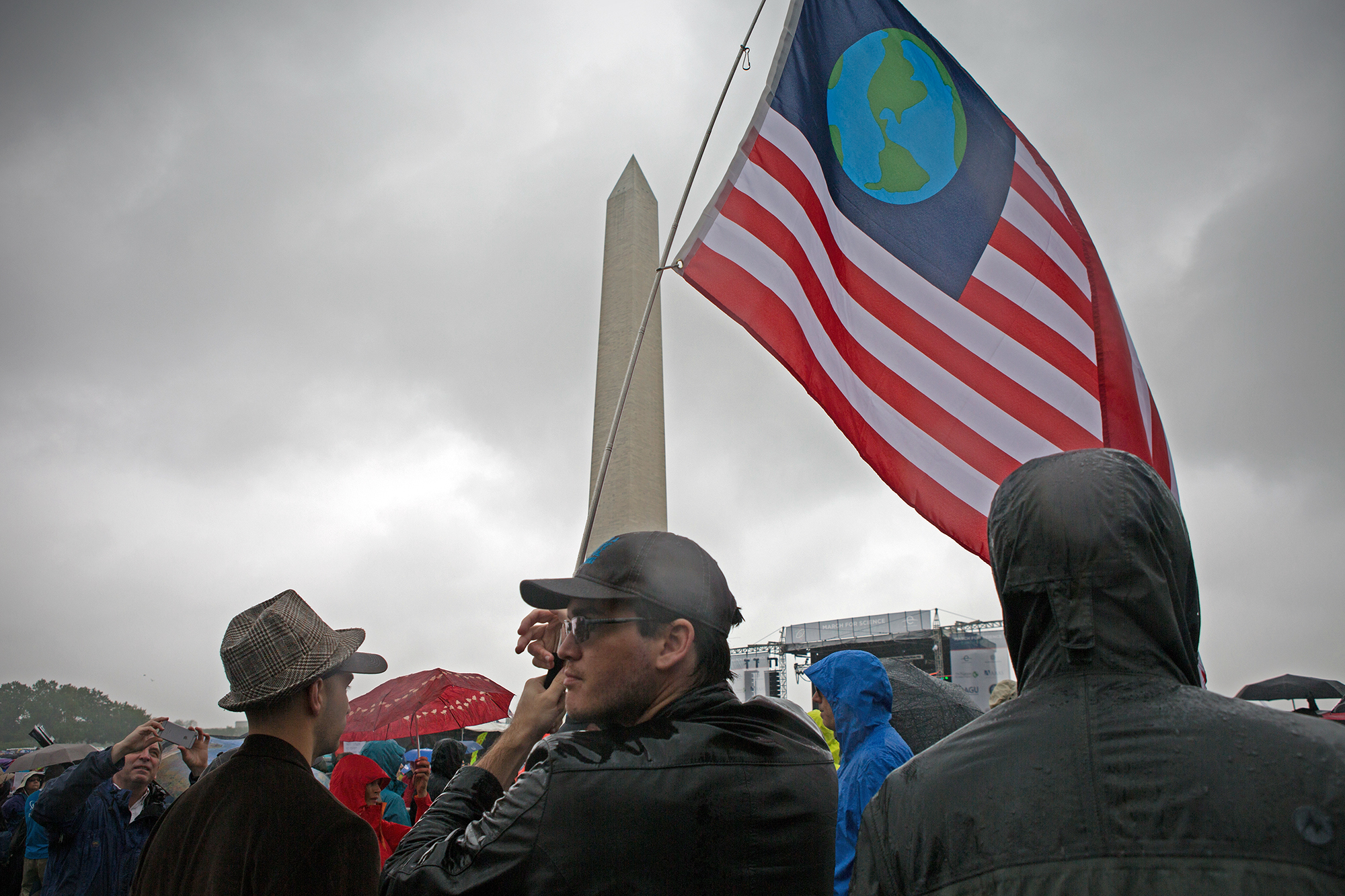 Daniel King waves a flag at Science March in Washington, D.C.