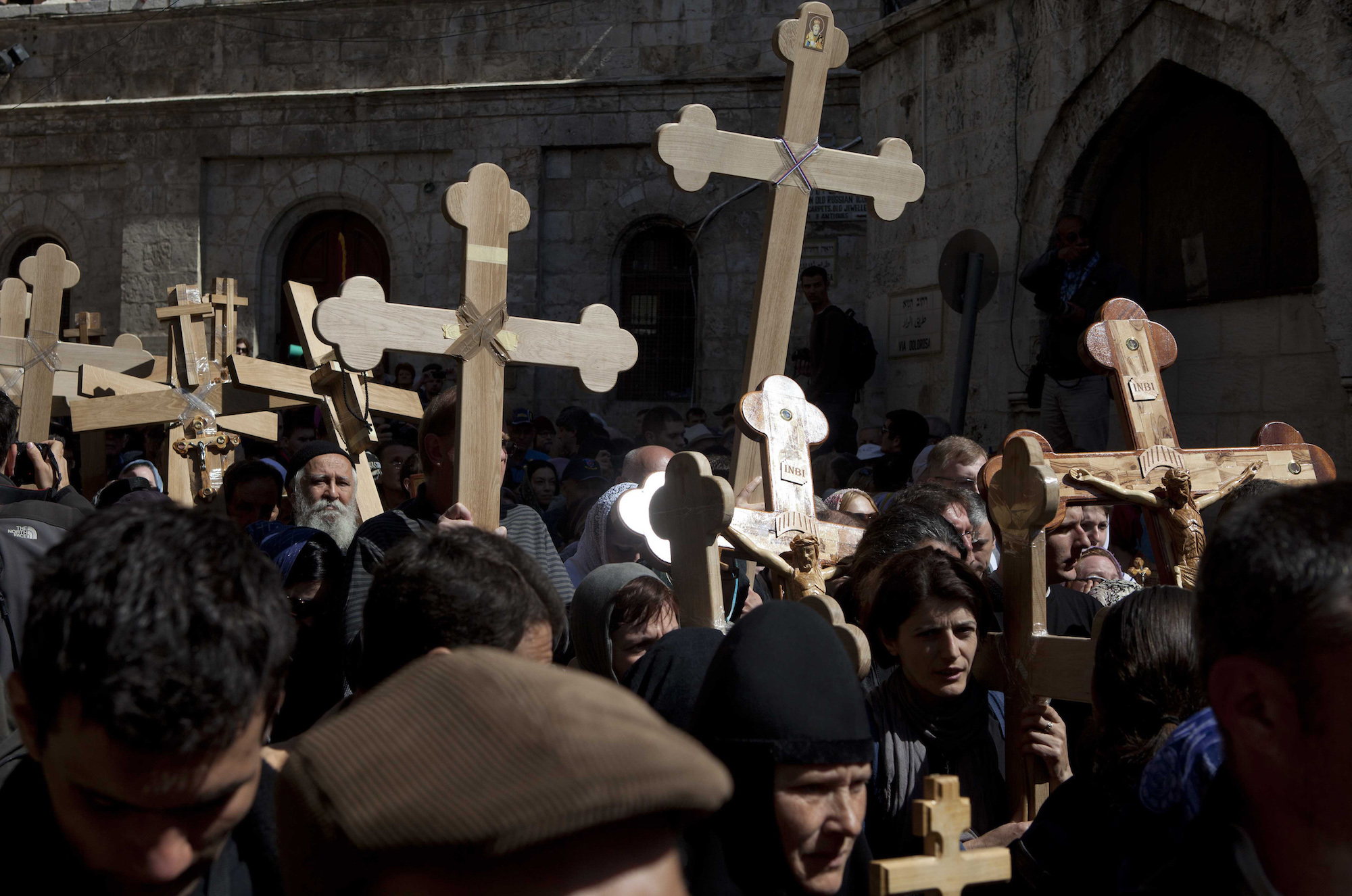 Christian worshippers hold crosses as they take part in the Eastern and Orthodox Church's Good Friday procession in the Old City of Jerusalem on April 13, 2012. Thousands of worshippers retraced the route Jesus took along the Via Dolorosa towards his crucifixion. (Photo by Heidi Levine/GroundTruth)