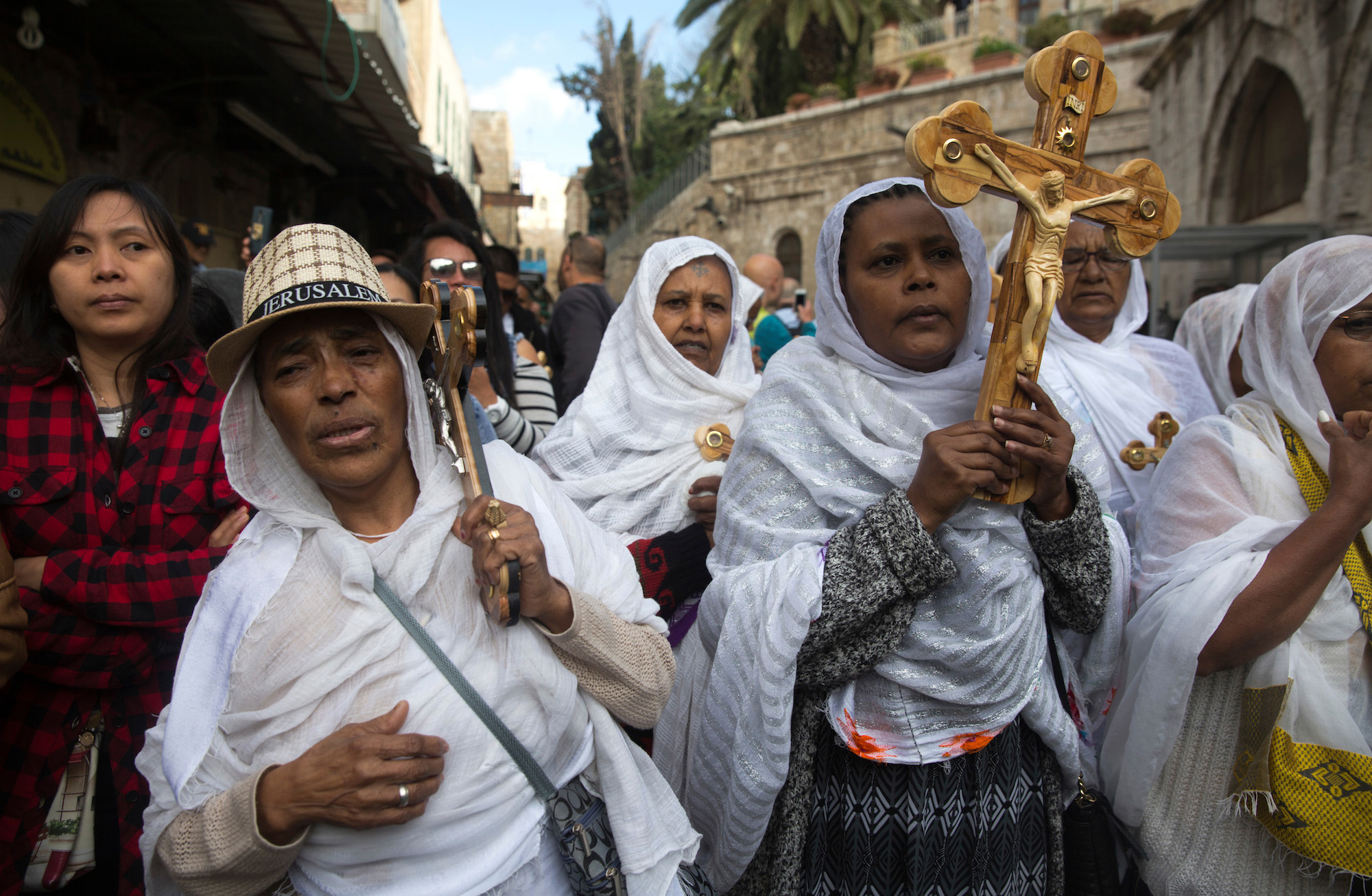 "Christian pilgrims from Eritrea are seen amongst the thousands of pilgrims from all over the world who carried wooden crosses along the Via Dolorosa, or ""The Way of Sorrow"" in the Old City of Jerusalem on April 14, 2017. The Good Friday procession remembers the day Jesus was sentenced to death and crucified. Christian faith holds that two days later, on Easter Sunday, Jesus rose from the dead. (Photo by Heidi Levine/GroundTruth)"