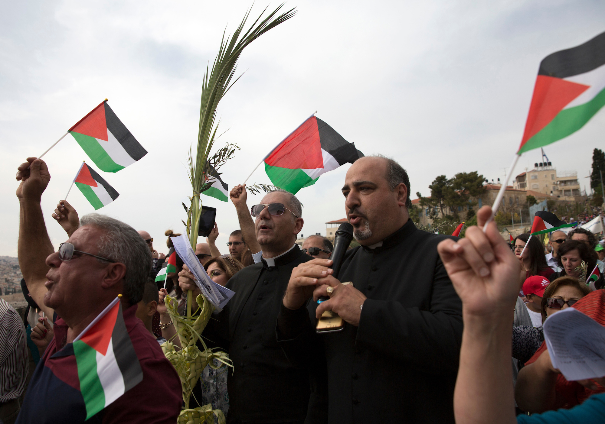 Palestinian Christian Pilgrims celebrate during a Palm Sunday procession on the Mt. of Olives on April 9, 2017. (Photo by Heidi Levine/Sipa Press).