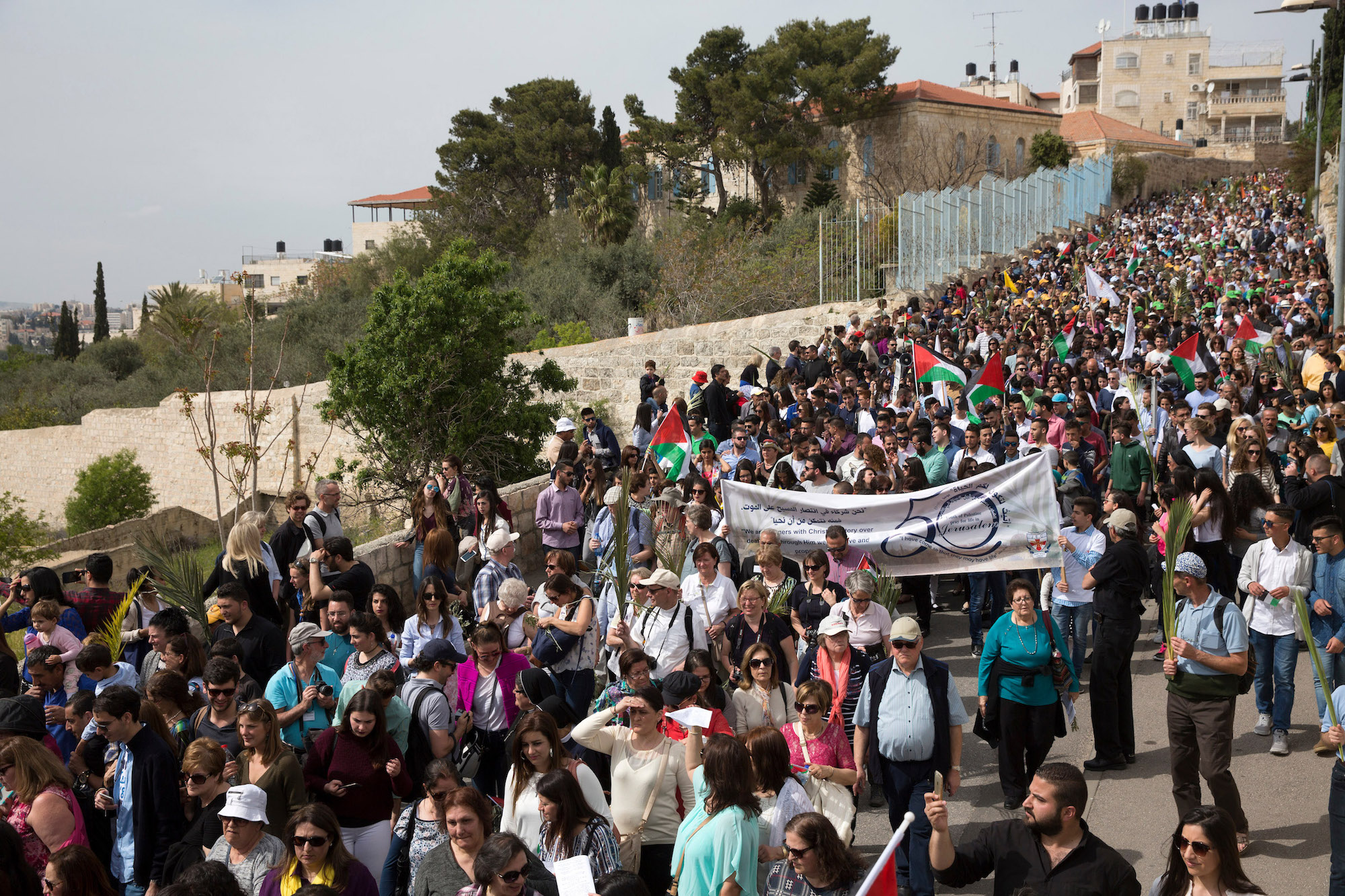 Christian Pilgrims celebrate during the Palm Sunday procession on the Mt. of Olives on April 9,2017. (Photo by Heidi Levine/Sipa Press).