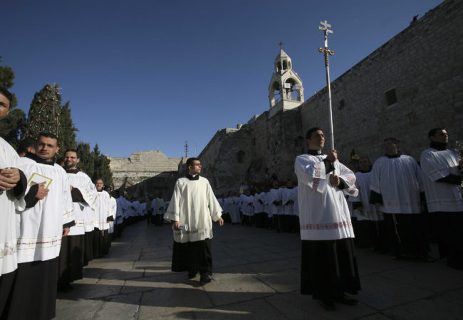 During Christmas celebrations, Catholic clergy participate in a procession outside the Church of the in the biblical city of Bethlehem, West Bank, on December 24th 2007. (Photo by Heidi Levine).