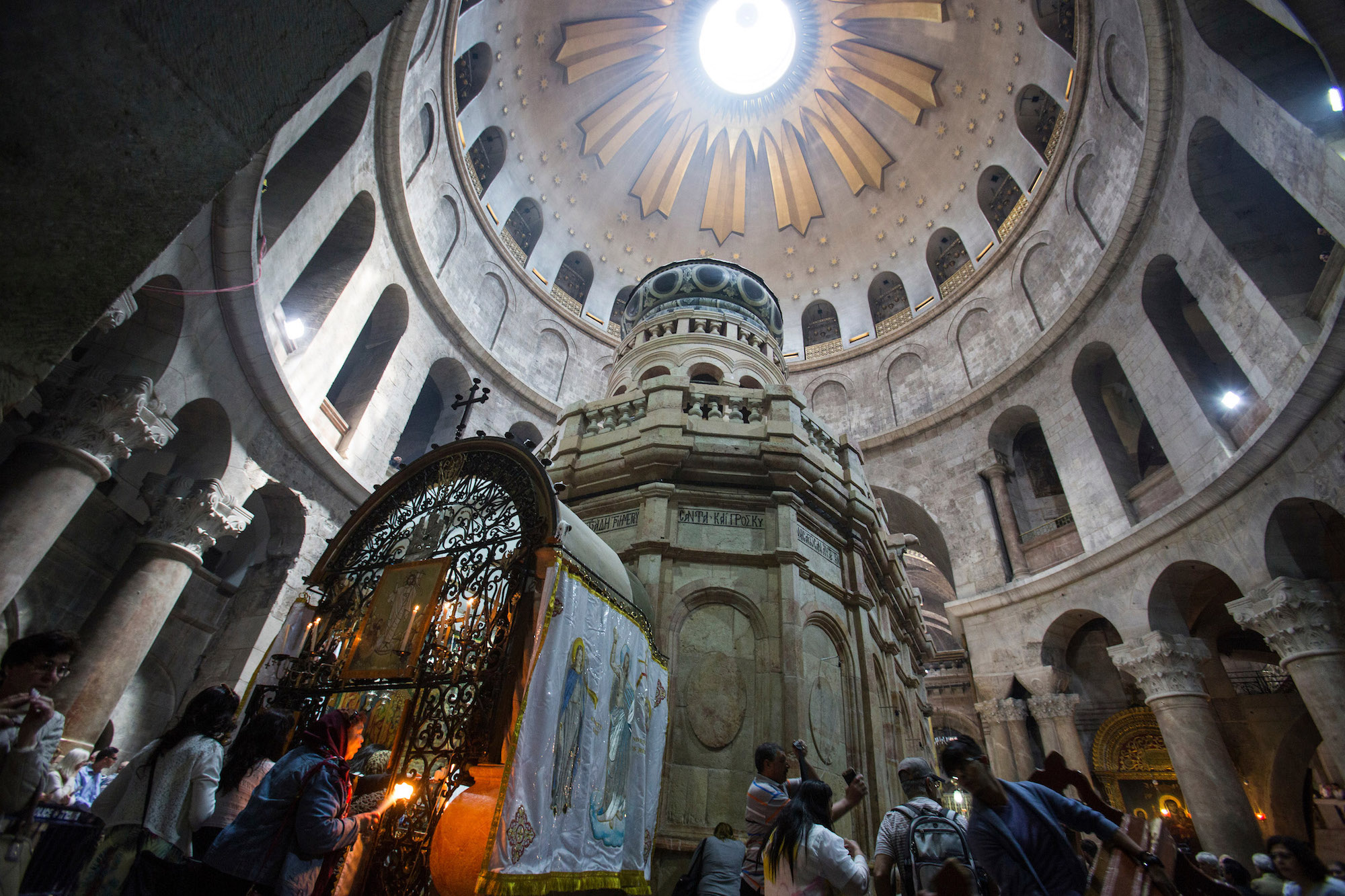 Christian pilgrims during the Easter Sunday procession at the Church of the Holy Sepulchre, which is believed to be the site of the crucifixion and burial of Jesus Christ. Thousands of Christians from around the world flocked to Jerusalem to commemorate the day when, according to Christian tradition, Jesus resurrected. Jerusalem, April 16, 2017 (Photo by Heidi Levine/GroundTruth).