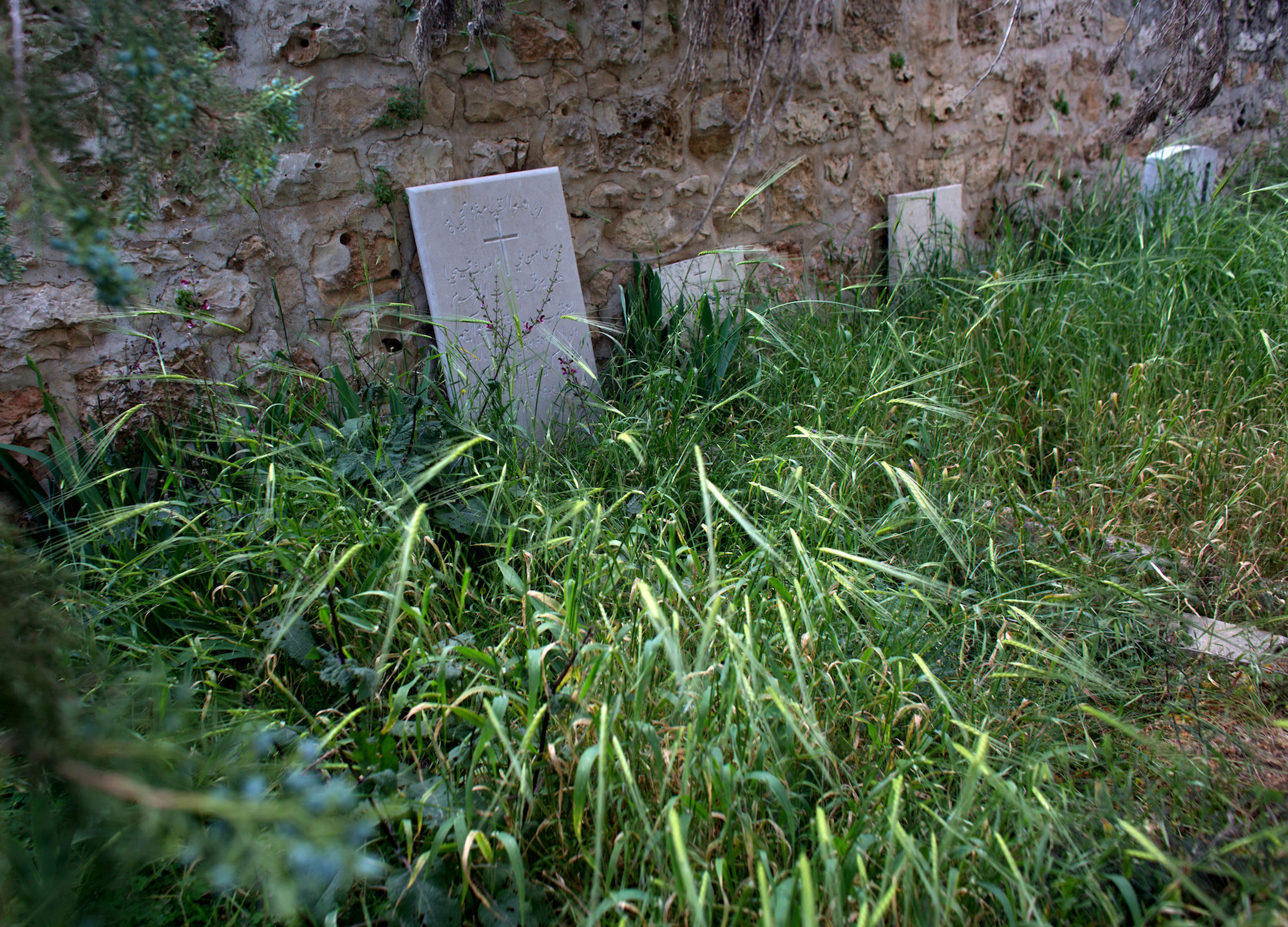 Christian tombstones are seen in a neglected Christian cemetery in the West Bank village of El Qubeibeh, also known as Emmaus. (Photo by Heidi Levine/GroundTruth)