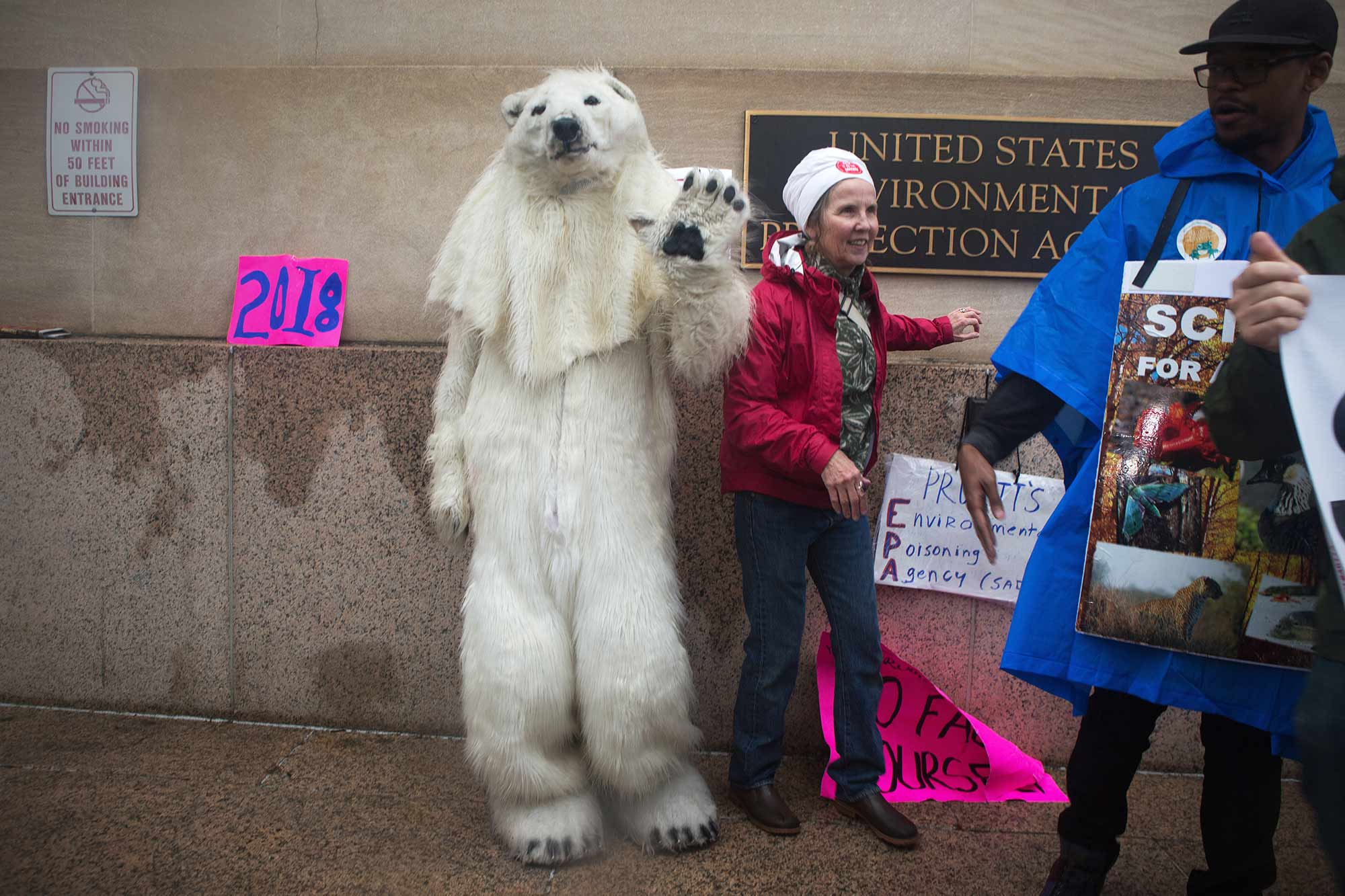 Woman with a person dressed in polar bear costume at March for Science, 2017.