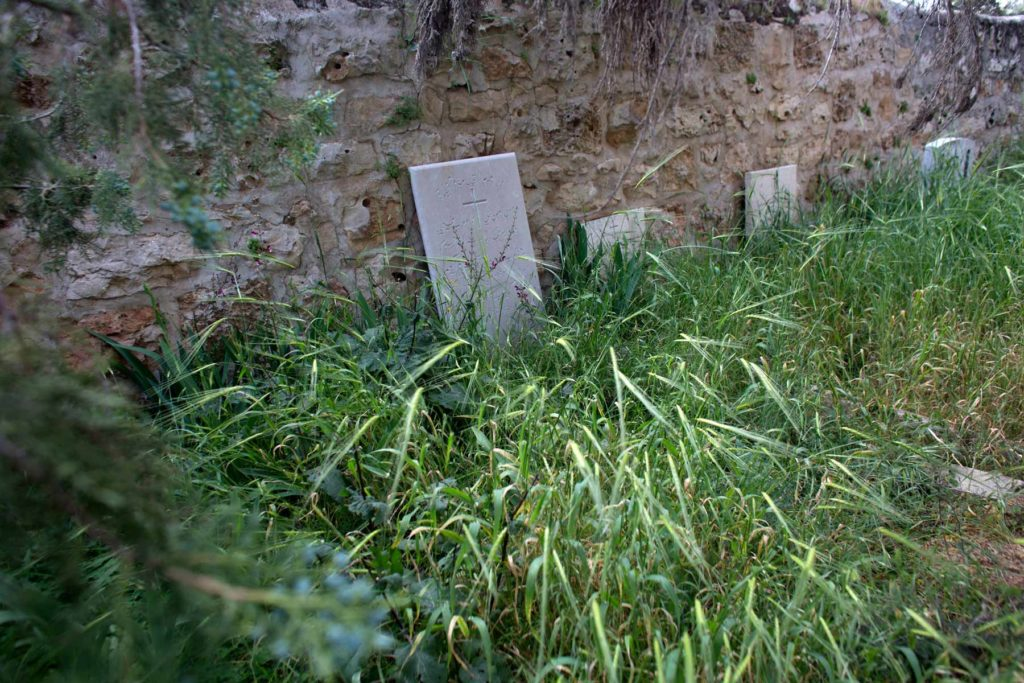 Christian tombstones are seen in a neglected Christian cemetery in Palestinian West Bank village of Emmaus. (Photo by Heidi Levine/GroundTruth)